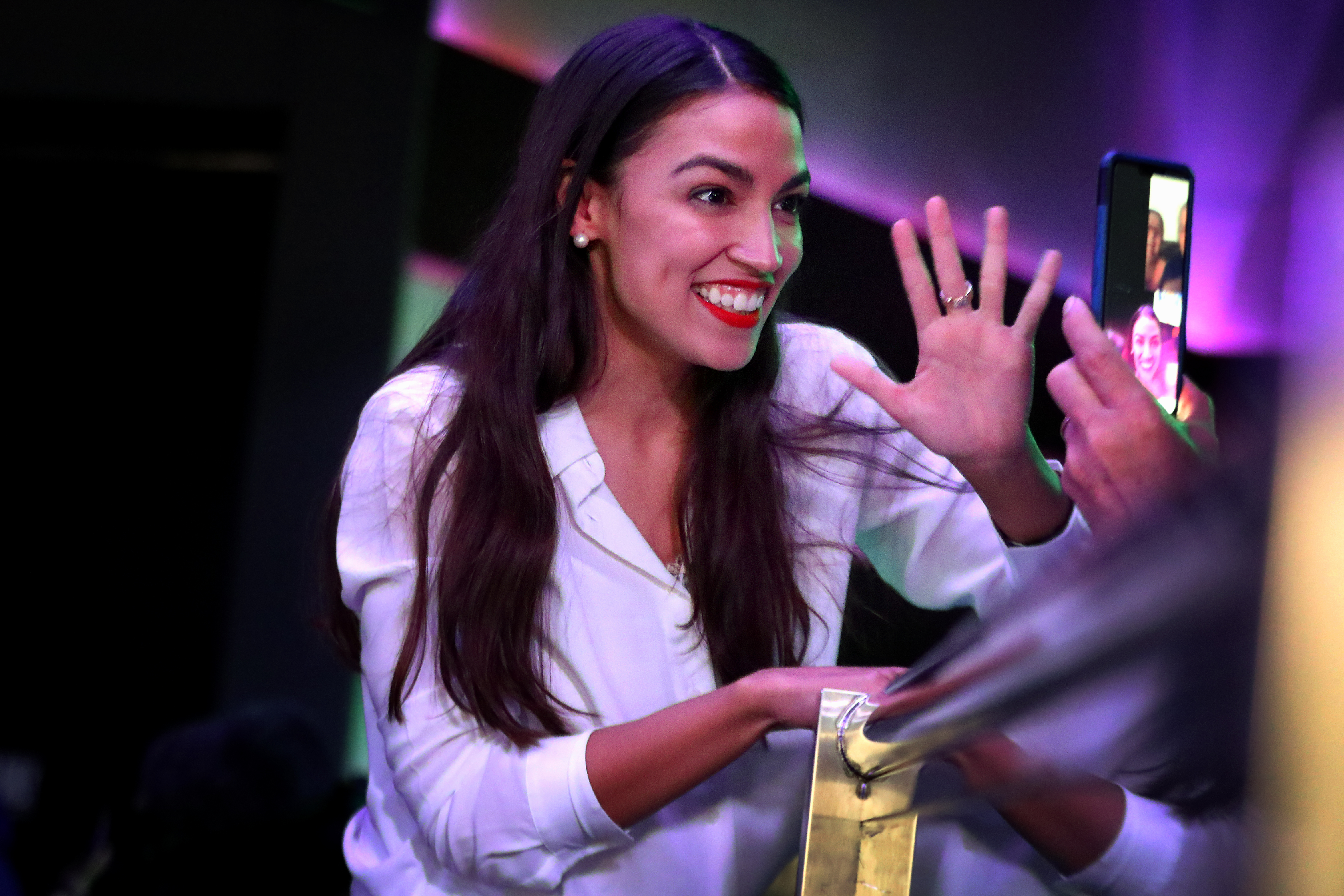 NEW YORK, NY - NOVEMBER 06: Alexandria Ocasio-Cortez celebrates her victory at La Boom night club in Queens on November 6, 2018 in New York City. With her win against Republican Anthony Pappas, Ocasio-Cortez became the youngest woman elected to Congress. (Photo by Rick Loomis/Getty Images)