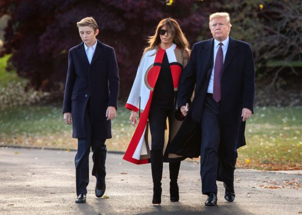 US President Donald Trump (R), First Lady Melania Trump and their son Barron depart the White House in Washington, DC, on November 20, 2018. - The Trumps are traveling to Mar-a-Lago in Palm Beach, Florida, for the Thanksgiving Holiday (Photo by Jim WATSON / AFP) (Photo credit should read JIM WATSON/AFP/Getty Images)