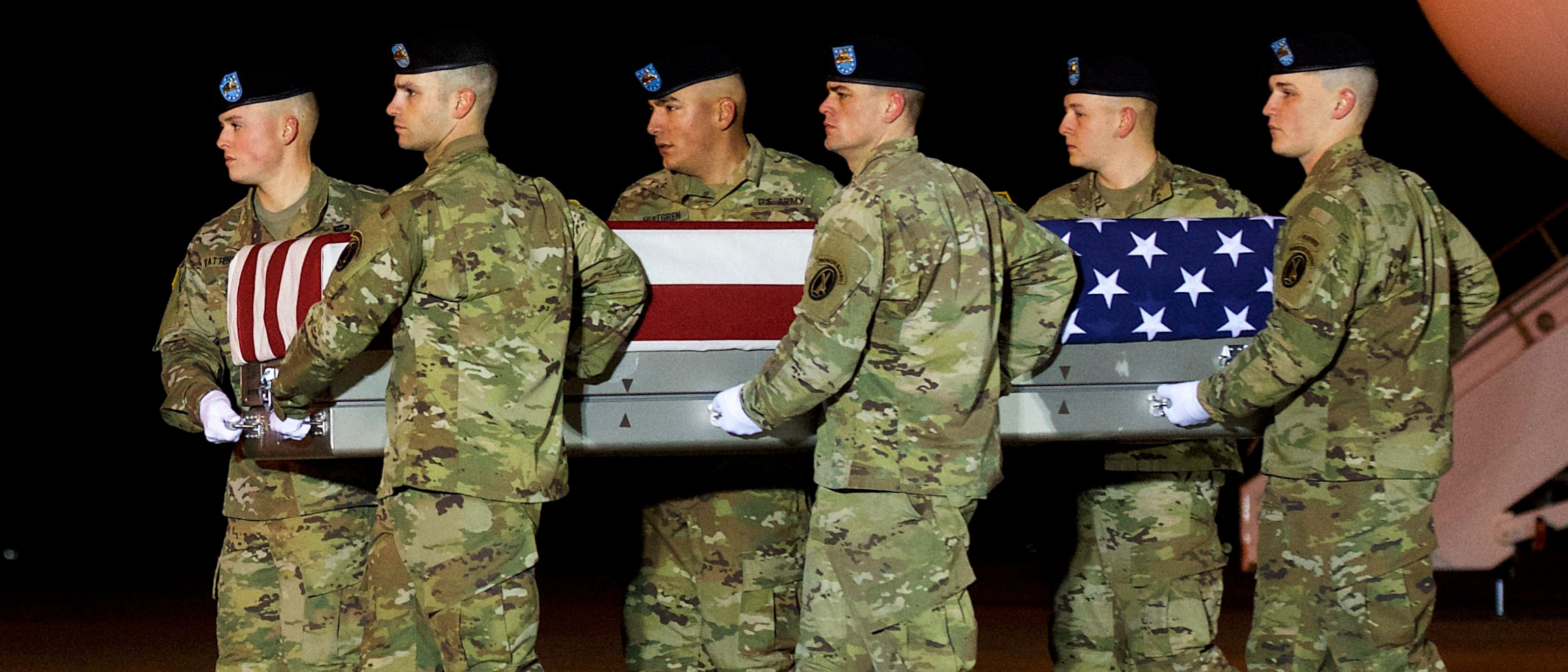 DOVER, DE - NOVEMBER 27: Armed forces carry a transfer case covered with an American flag during a dignified transfer for fallen service member Sergeant Leandro A.S. Jasso on November 27, 2018 in Dover, Delaware. Sgt. Jasso of Leavenworth, Washington was killed in Afghanistan while engaging enemy forces. (Photo by Mark Makela/Getty Images)
