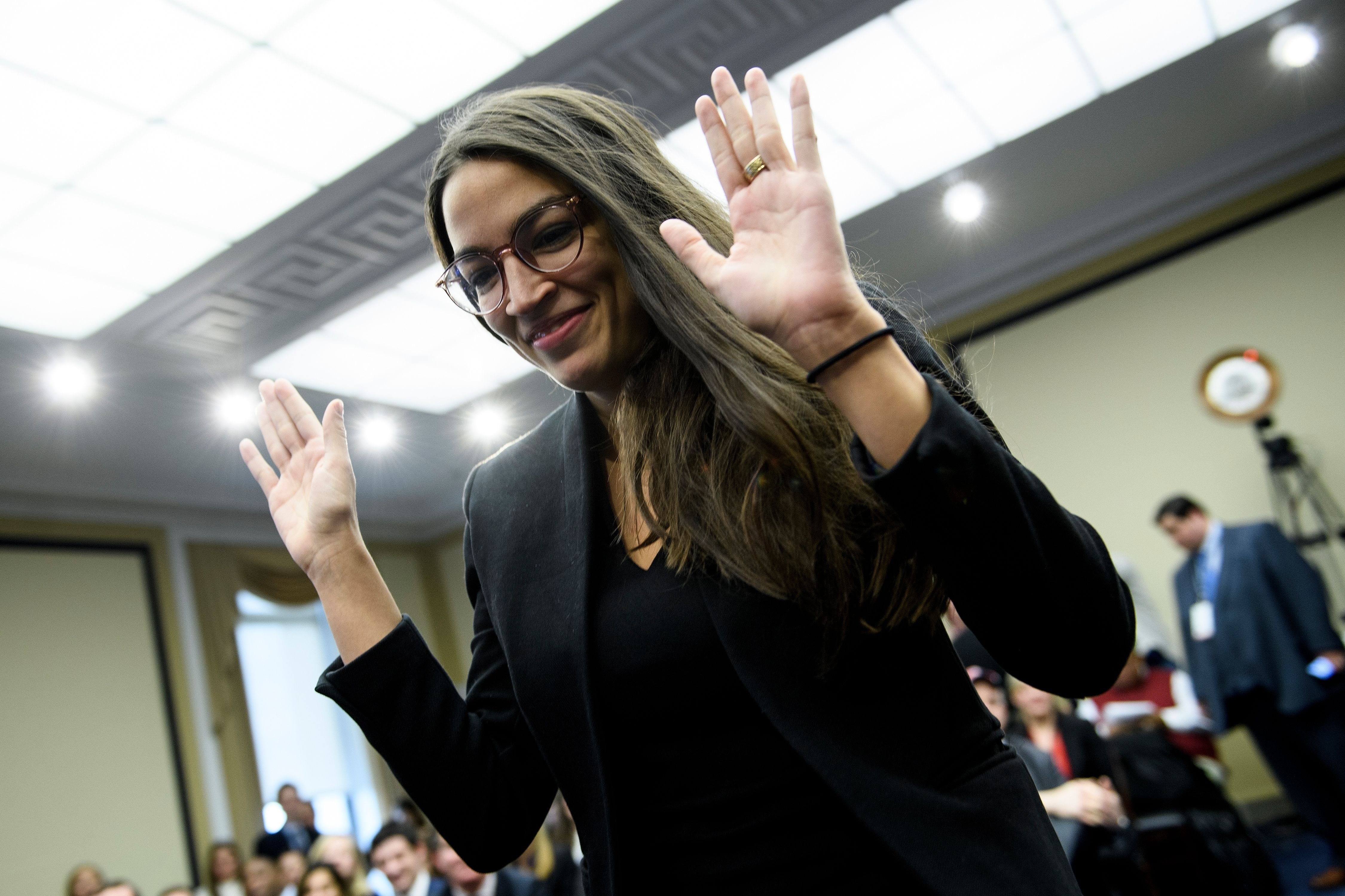 US Representative-elect Alexandria Ocasio-Cortez (D-NY) walks up to participate in drawing a lottery number for her new office on Capitol Hill November 30, 2018 in Washington, DC. (Photo: BRENDAN SMIALOWSKI/AFP/Getty Images)