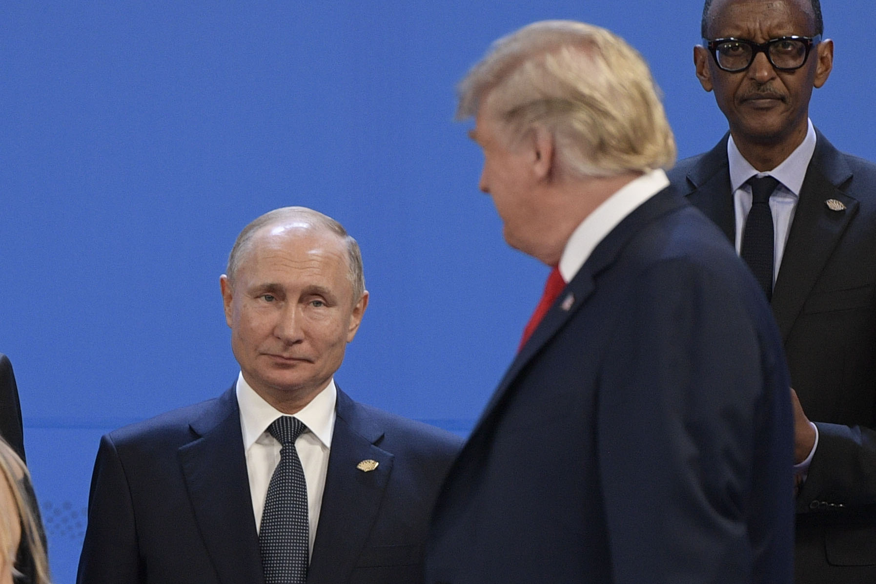 US President Donald Trump (R), looks at Russia's President Vladimir Putin as they take place for a family photo, during the G20 Leaders' Summit in Buenos Aires, on November 30, 2018. (JUAN MABROMATA/AFP/Getty Images)