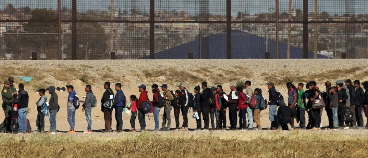Nearly 150 Central American migrants seeking political asylum in the United States are detained by the Border Patrol, after entering the US through the Rio Grande, along the border with Ciudad Juarez, Chihuahua state, Mexico, on December 3, 2018. - Thousands of Central American migrants, mostly Hondurans, have trekked for over a month in the hopes of reaching the United States. (Photo by HERIKA MARTINEZ / AFP)