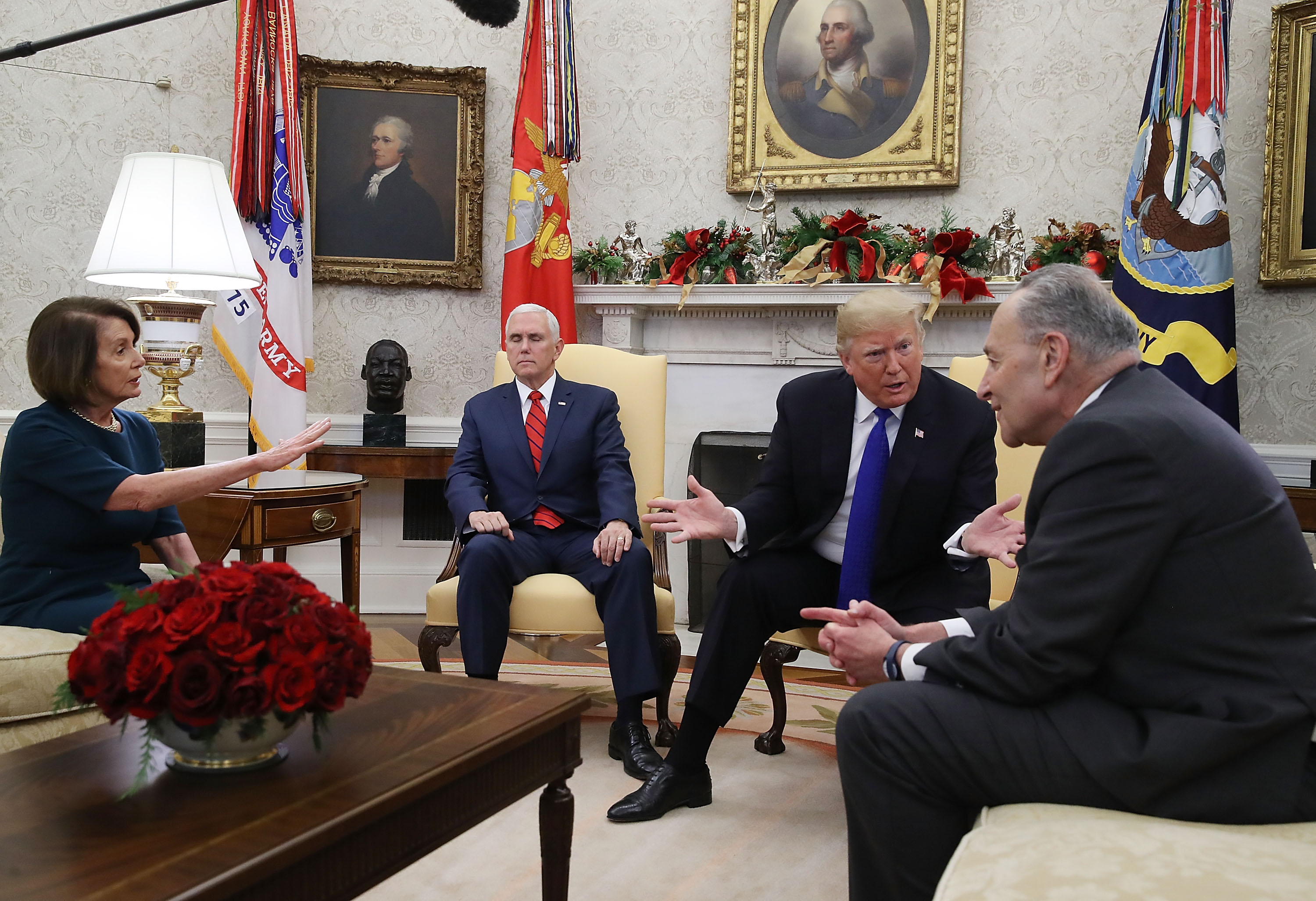 WASHINGTON, DC - DECEMBER 11: U.S. President Donald Trump (2R) talks about border security with Senate Minority Leader Chuck Schumer (D-NY) (R) and House Minority Leader Nancy Pelosi (D-CA) as Vice President Mike Pence sits nearby in the Oval Office on December 11, 2018 in Washington, DC. (Photo by Mark Wilson/Getty Images)