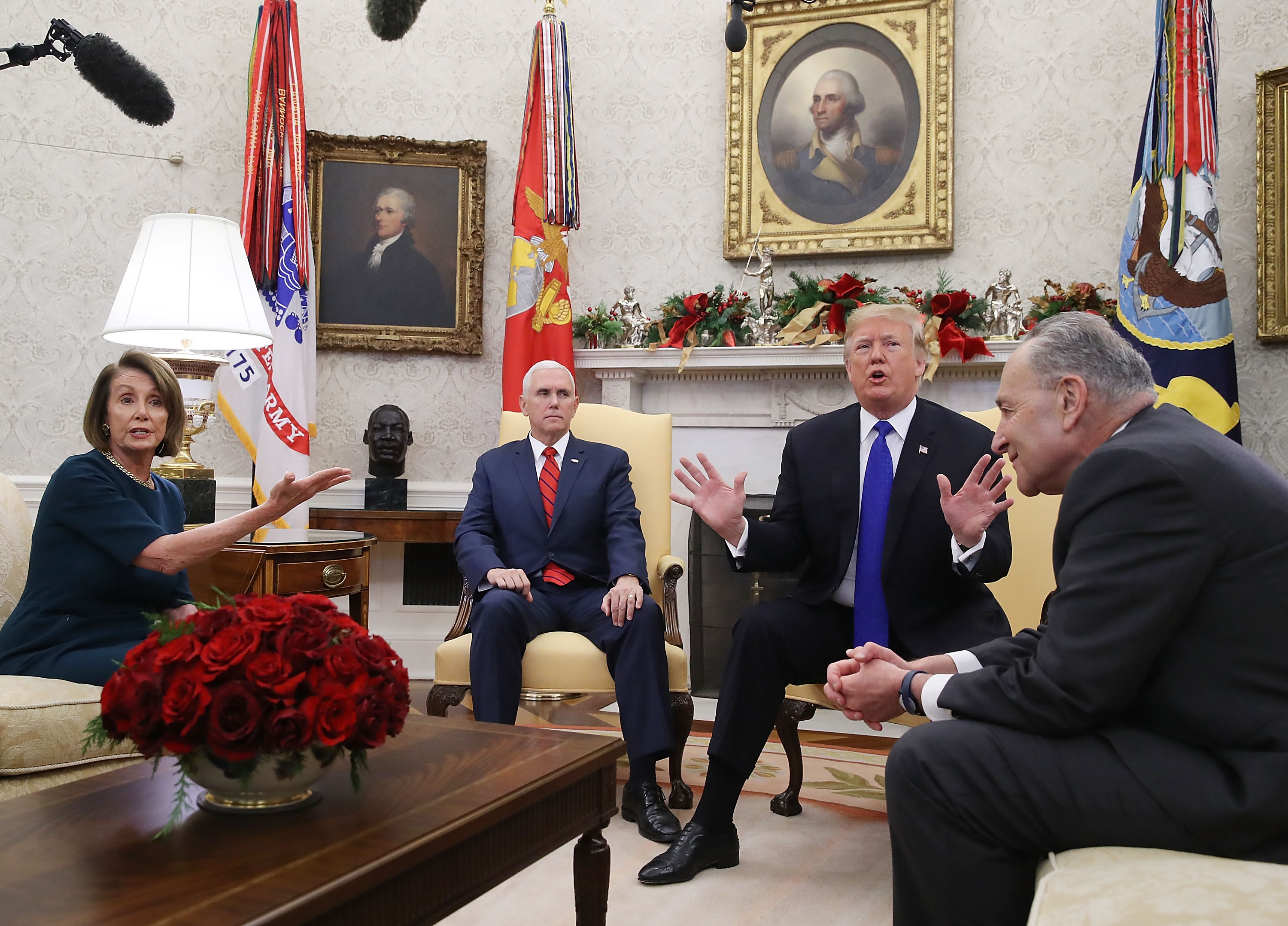 U.S. President Donald Trump (second from right) argues about border security with Senate Minority Leader Chuck Schumer (right) and House Minority Leader Nancy Pelosi as Vice President Mike Pence sits nearby in the Oval Office on December 11, 2018 in Washington, DC. (Photo by Mark Wilson/Getty Images)