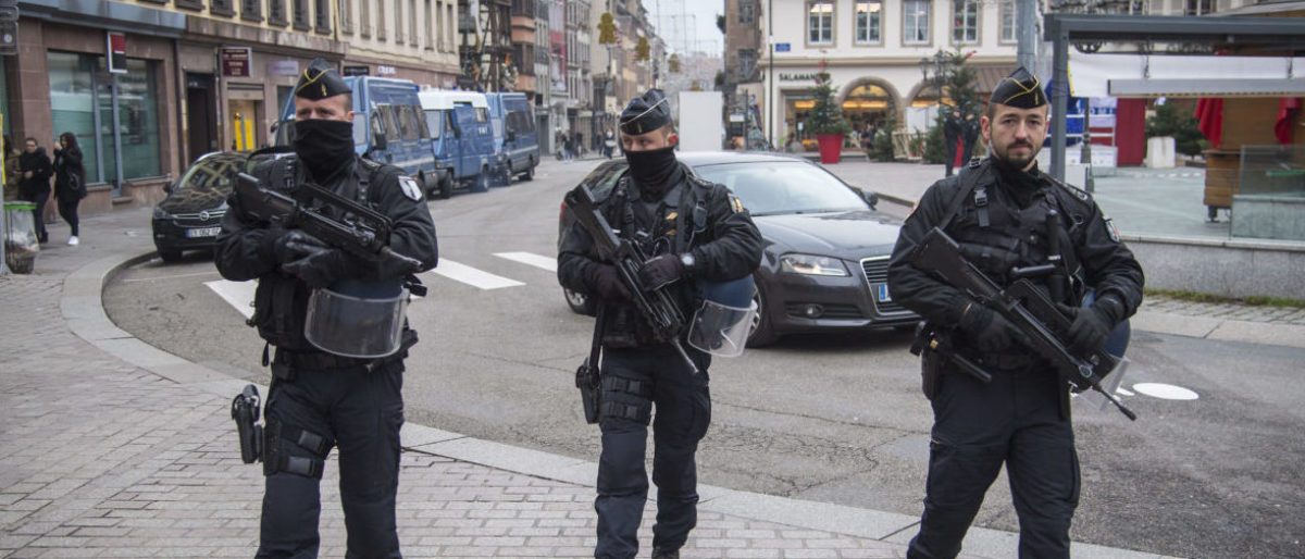 STRASBOURG, FRANCE - DECEMBER 12: Police officers control the streets near the Christmas market where the day before a man shot 14 people, killing at least three, on December 12, 2018 in Strasbourg, France. Police have identified the man as Cherif Chekatt, a French citizen on a police terror watch-list. Chekatt exchanged gunfire with soldiers after the attack, is reportedly injured and is still on the loose. (Photo by Thomas Lohnes/Getty Images)