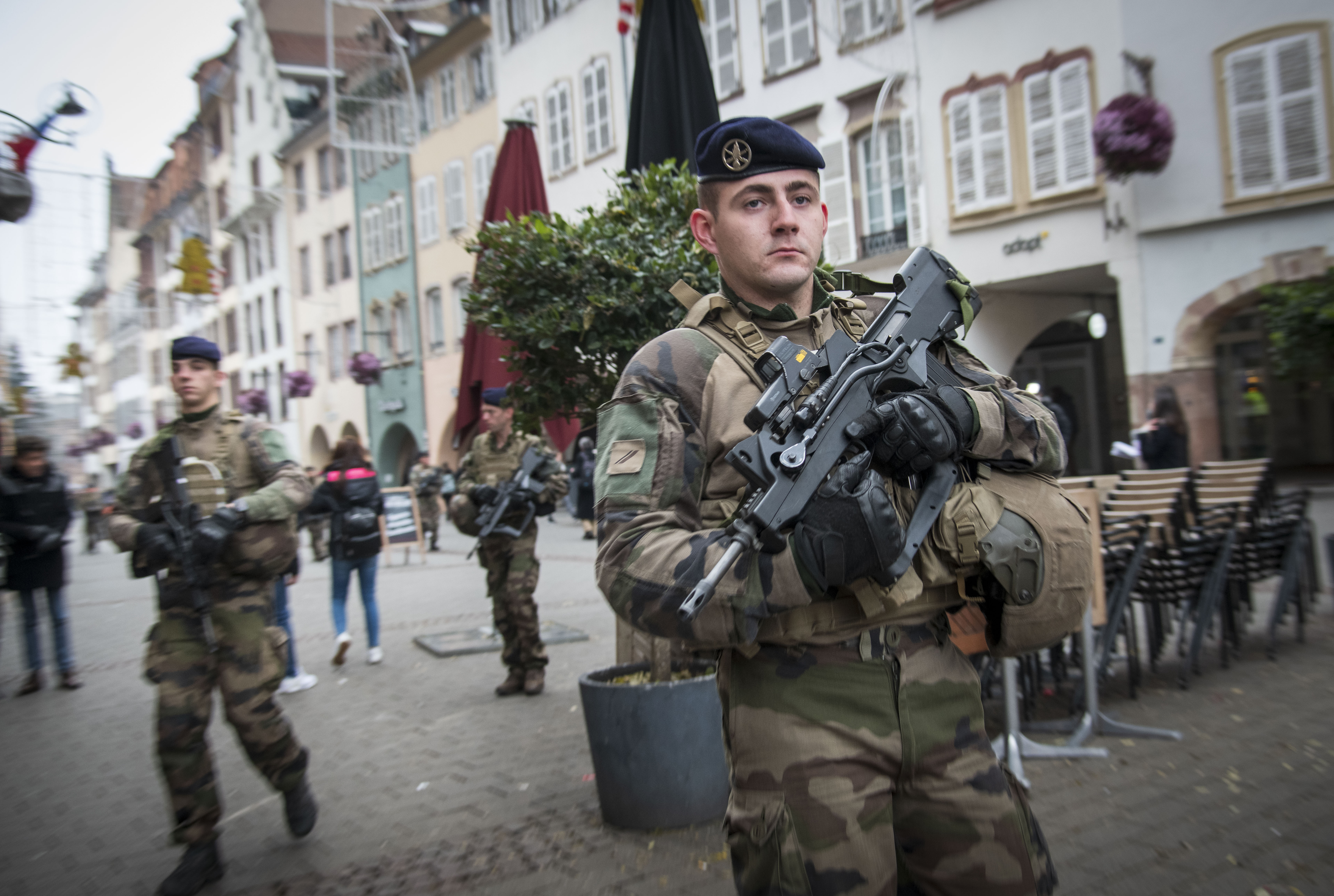 STRASBOURG, FRANCE - DECEMBER 12: Soldiers patrol near the Christmas market where, yesterday, a man shot 14 people, killing at least three, on December 12, 2018 in Strasbourg, France. Police have identified the man as Cherif Chekatt, a French citizen on a police terror watch-list. Chekatt exchanged gunfire with soldiers after the attack, is reportedly injured and is still on the loose. (Photo by Thomas Lohnes/Getty Images)