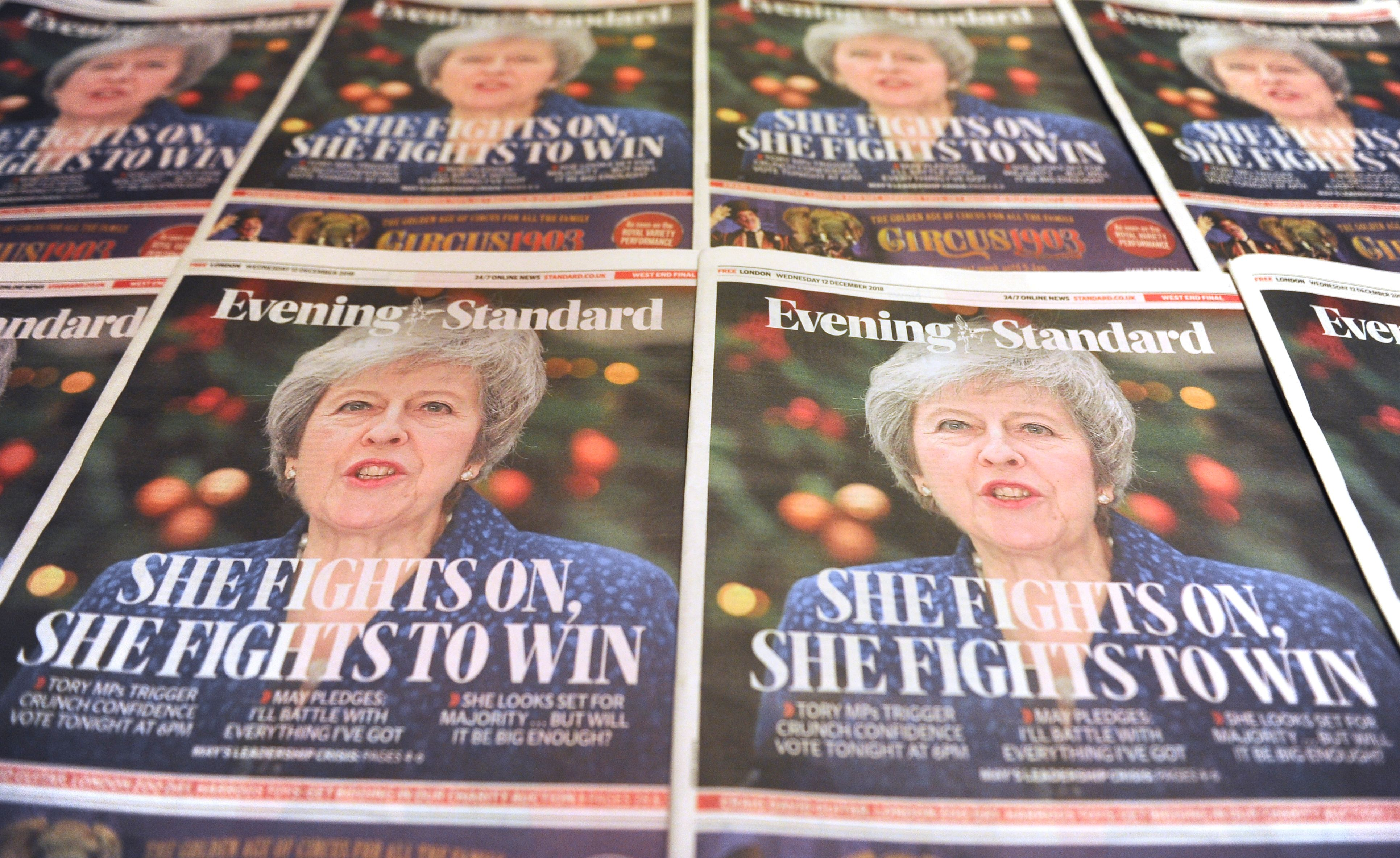Copies of the Evening Standard, London's daily free newspaper with Britain's Prime Minister Theresa May on the front cover following the confidence vote are arranged in London on December 12, 2018. (DANIEL SORABJI/AFP/Getty Images)