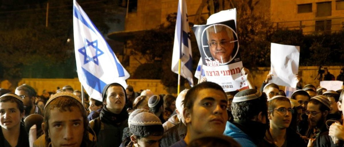 Right-wing Israelis, mostly from settlements in the occupied West Bank, protest outside the residence of Prime Minister Benjamin Netanyahu in Jerusalem on December 13, 2018 following the recent attacks by Palestinian militants killing 3 Israelis and wounding several others since the start of the week. (GALI TIBBON/AFP/Getty Images)