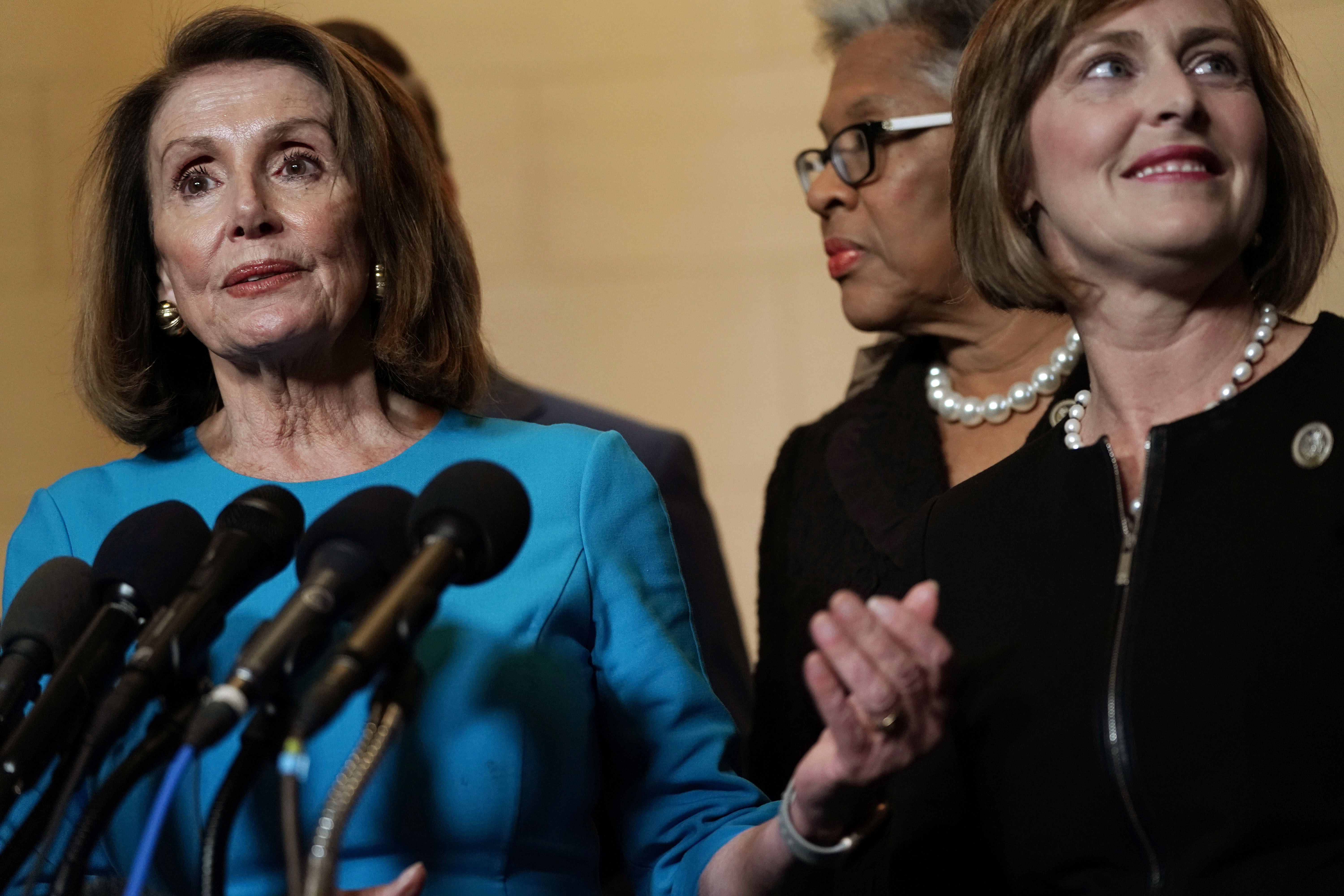 WASHINGTON, DC - NOVEMBER 28: U.S. House Minority Leader Rep. Nancy Pelosi (D-CA) (L) speaks to members of the media as Rep. Joyce Beatty (D-OH) (2nd L), and Rep. Kathy Castor (D-FL) (R) listen at the lobby of Longworth House Office Building November 28, 2018 in Washington, DC. House Democrats have nominated Rep. Nancy Pelosi to run for Speaker of the House for the 116th Congress. (Photo by Alex Wong/Getty Images)