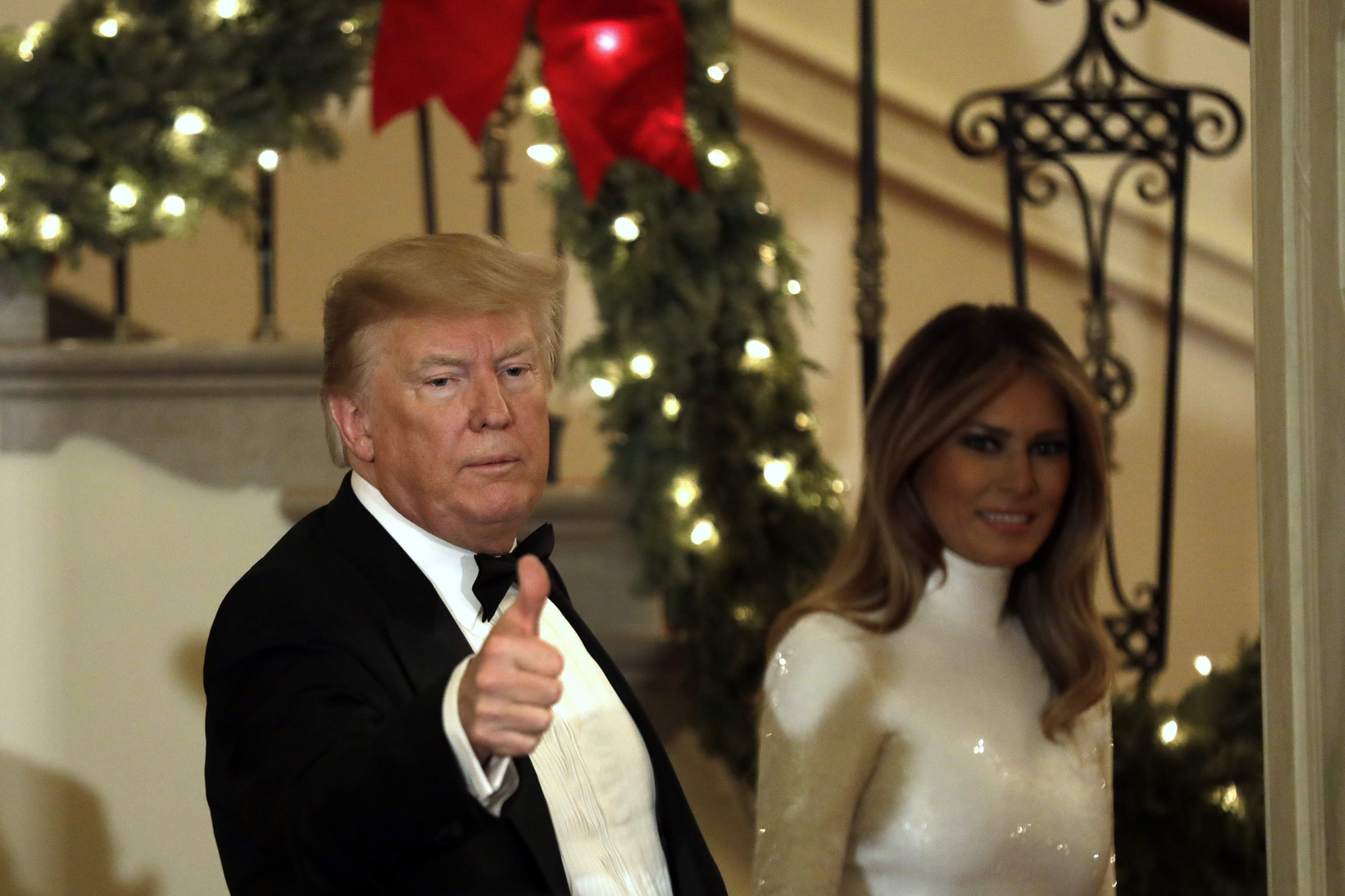 WASHINGTON, DC - DECEMBER 15: U.S. President Donald Trump and First Lady Melania Trump greet guests at the Congressional Ball at White House in Washington on December 15, 2018. (Photo by Yuri Gripas-Pool/Getty Images)