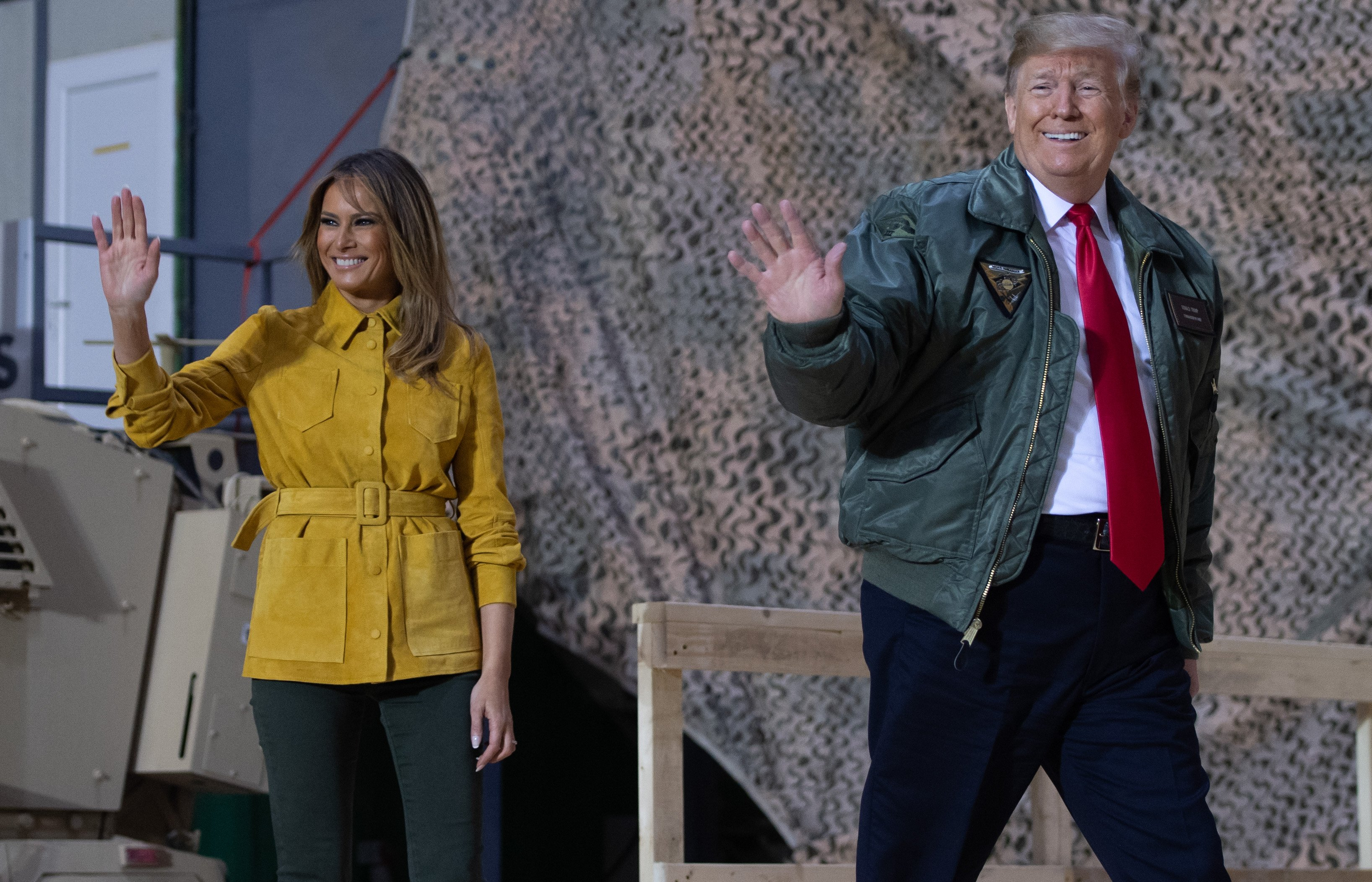 US President Donald Trump and First Lady Melania Trump arrive to speak to members of the US military during an unannounced trip to Al Asad Air Base in Iraq on December 26, 2018. - President Donald Trump arrived in Iraq on his first visit to US troops deployed in a war zone since his election two years ago (Photo by SAUL LOEB/AFP/Getty Images)