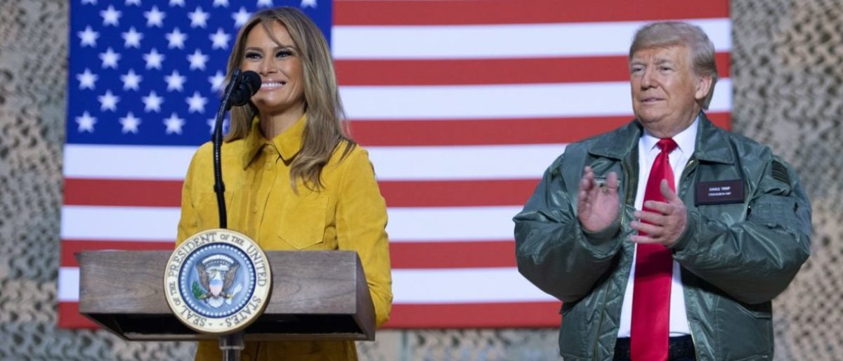 US President Donald Trump and First Lady Melania Trump speak to members of the US military during an unannounced trip to Al Asad Air Base in Iraq on December 26, 2018. - President Donald Trump arrived in Iraq on his first visit to US troops deployed in a war zone since his election two years ago (Photo by SAUL LOEB / AFP)
