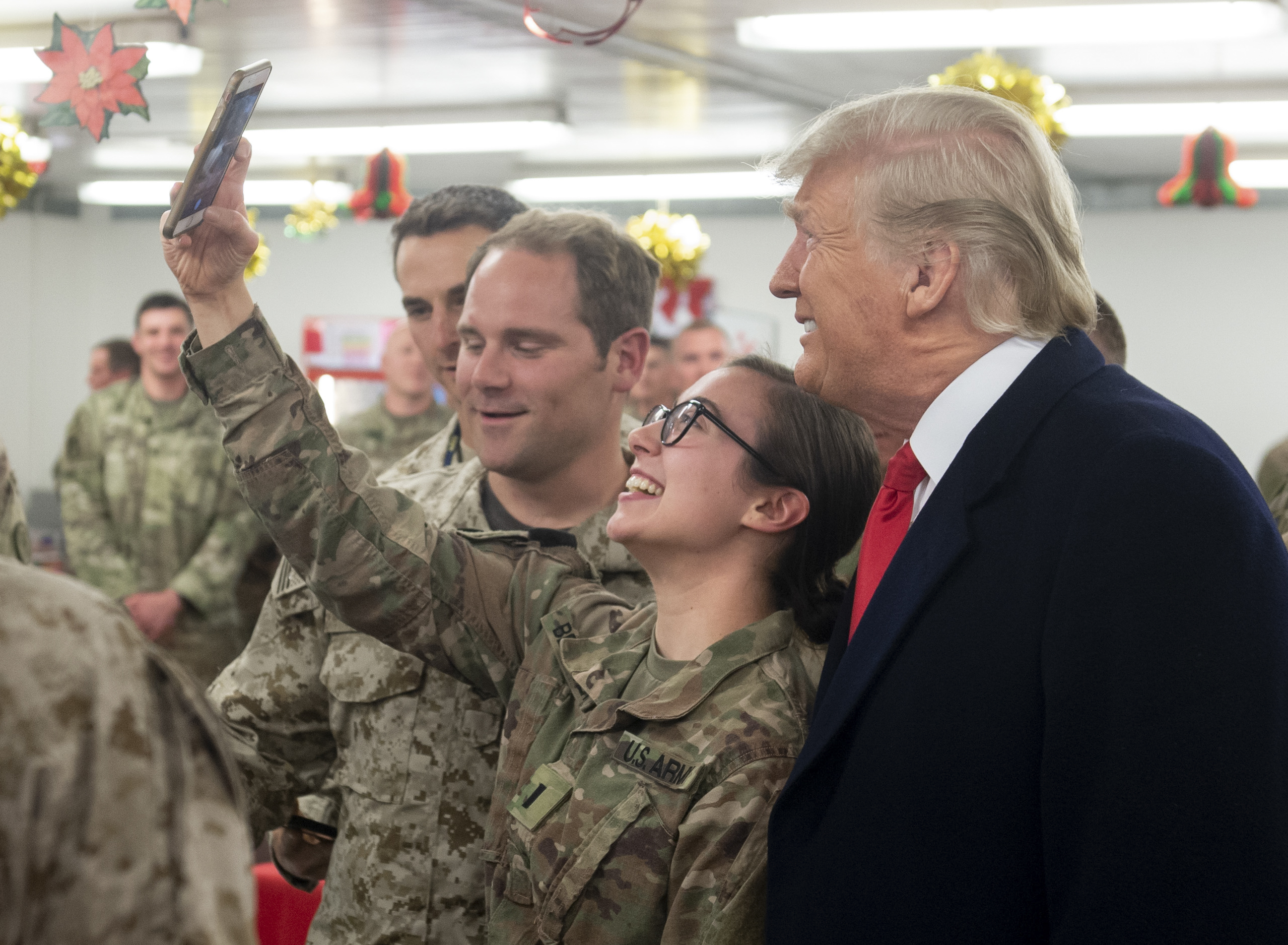 US President Donald Trump greets members of the US military during an unannounced trip to Al Asad Air Base in Iraq on December 26, 2018. - President Donald Trump arrived in Iraq on his first visit to US troops deployed in a war zone since his election two years ago (Photo by SAUL LOEB / AFP) (Photo credit should read SAUL LOEB/AFP/Getty Images)