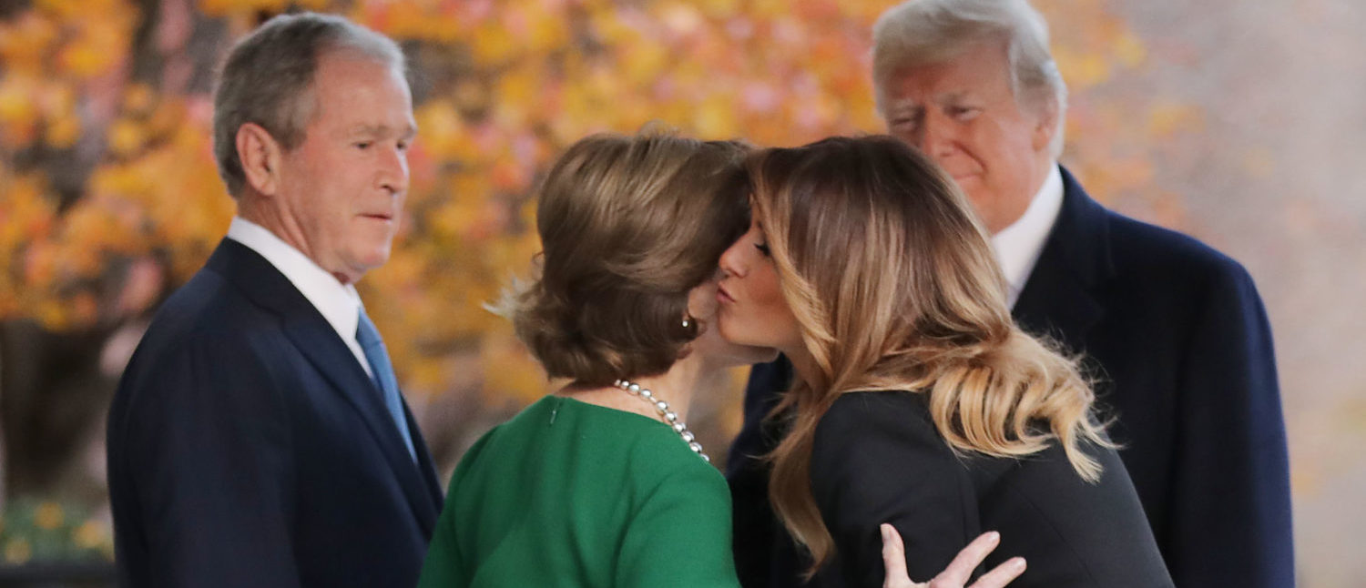 WASHINGTON, DC - DECEMBER 04: (AFP OUT) Former first lady Laura Bush and former President George W. Bush greet President Donald Trump and first lady Melania Trump outside of Blair House December 04, 2018 in Washington, DC. The Trumps were paying a condolence visit to the Bush family who are in Washington for former President George H.W. Bush's state funeral and related honors. (Photo by Chip Somodevilla/Getty Images)