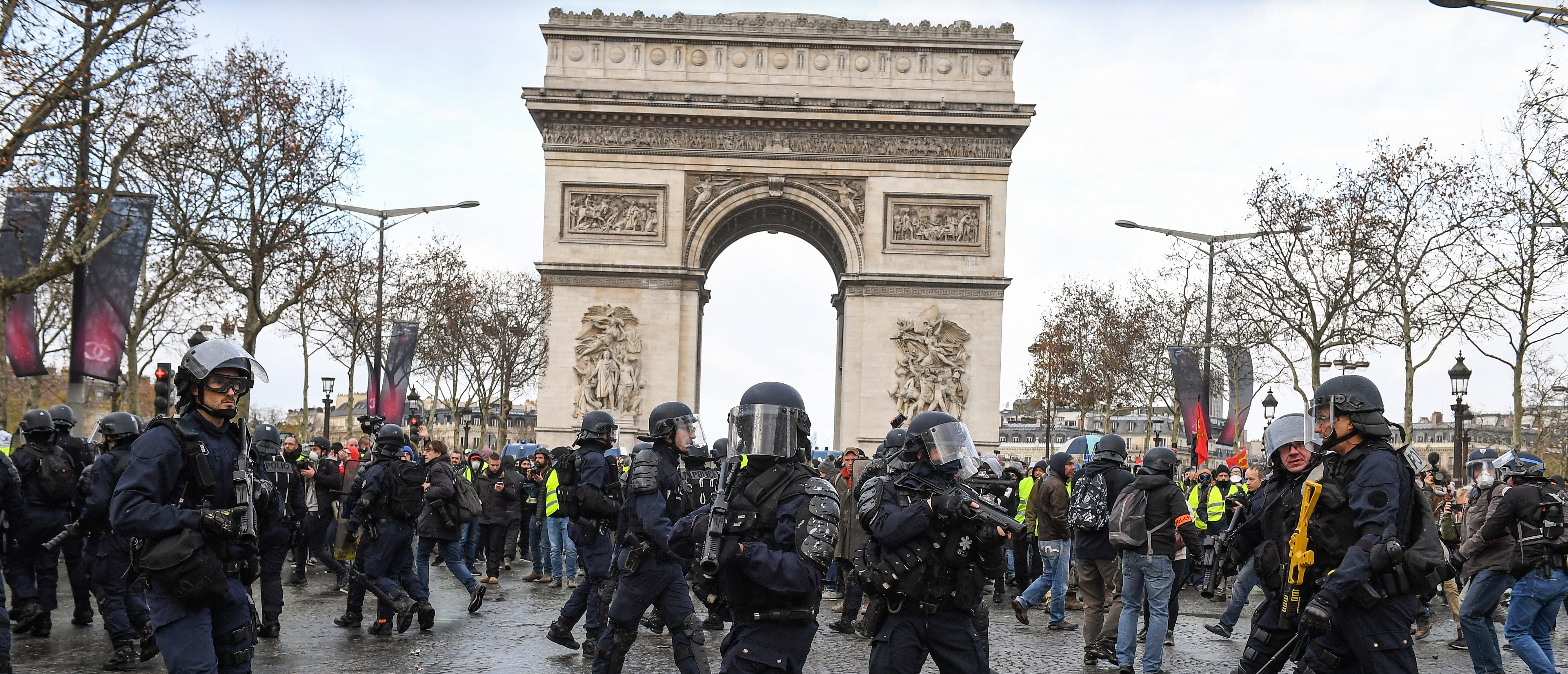 PARIS, FRANCE - DECEMBER 08: French police stand gaurd as demonstrators take part in the demonstration of the yellow vests at the Arc de Triomphe on December 8, 2018 in Paris France. ''Yellow Vests' ('Gilet Jaunes' or 'Vestes Jaunes') is a protest movement without political affiliation which was inspired by opposition to a new fuel tax. After a month of protests, which have wrecked parts of Paris and other French cities, there are fears the movement has been infiltrated by 'ultra-violent' protesters. Today's protest has involved at least 5,000 demonstrators gathering in the Parisian city centre with police having made over 200 arrests so far. (Photo by Jeff J Mitchell/Getty Images)