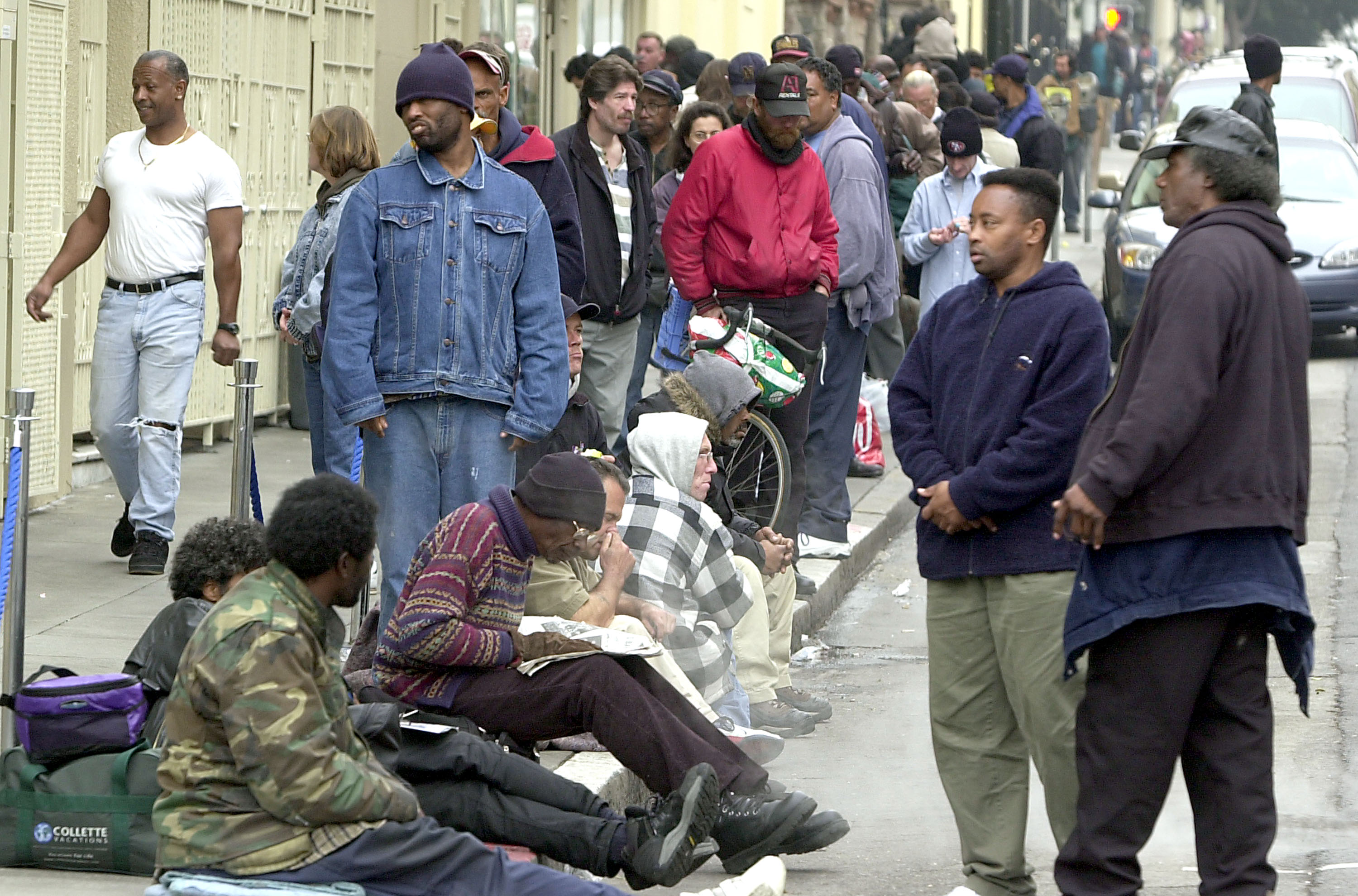 SAN FRANCISCO, CA - DECEMBER 6: Dozens of homeless people line up for a free meal at St. Anthony's church December 6, 2002 in San Francisco, California. San Francisco has attracted increasing numbers of homeless people in recent years. Official estimates tally homeless in the area to more than 12,000. Some people believe that the homeless are drawn to the area, in part, by welfare payments that are far too generous. (Photo by Justin Sullivan/Getty Images)