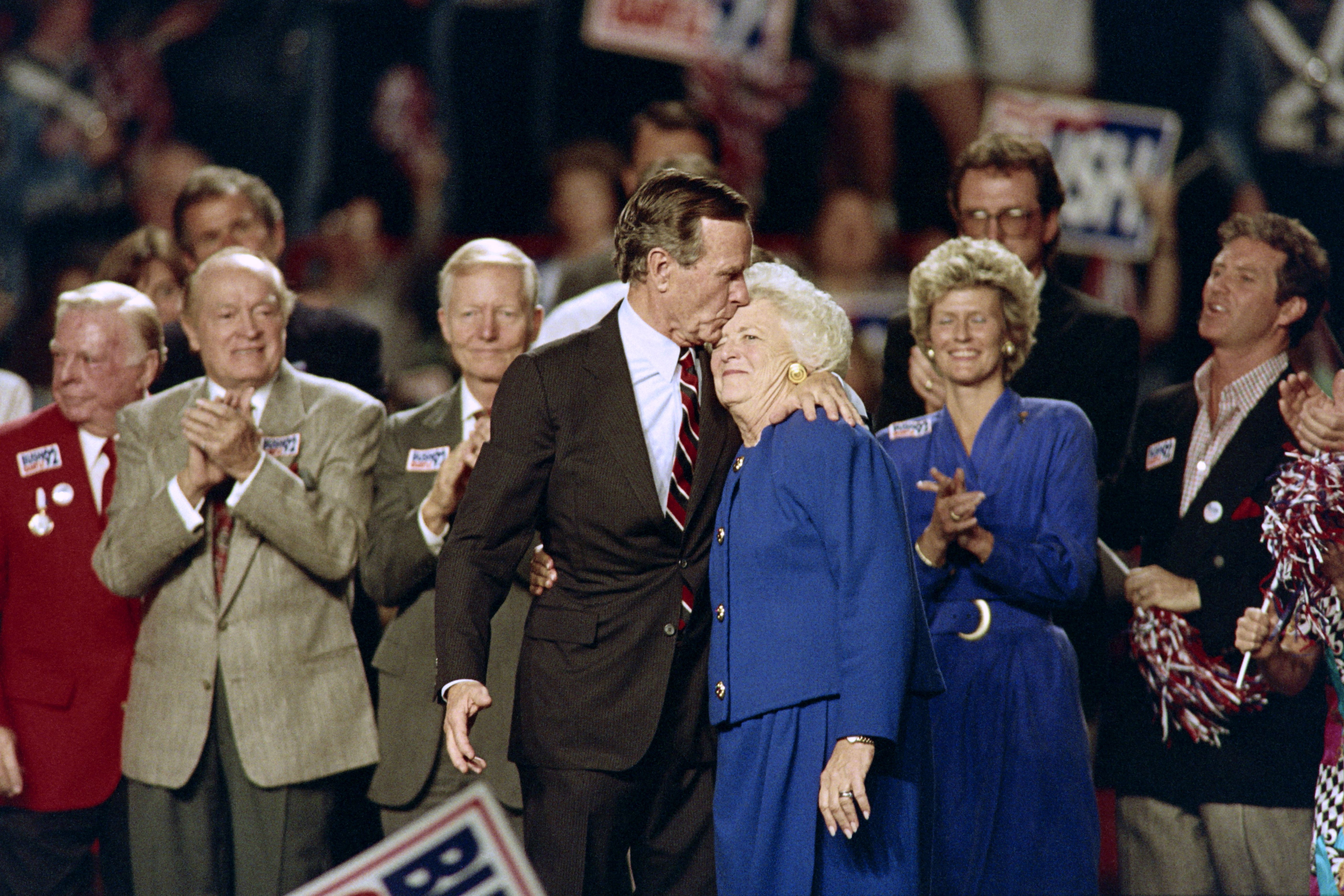 US President George Bush kisses his wife Barbara at the end of a rally held at the Astro Arena on November 2, 1992 on the eve of the 1992 presidential election. President Bush trails Democratic candidate Bill Clinton in pre-election polls. AFP PHOTO EUGENE GARCIA
