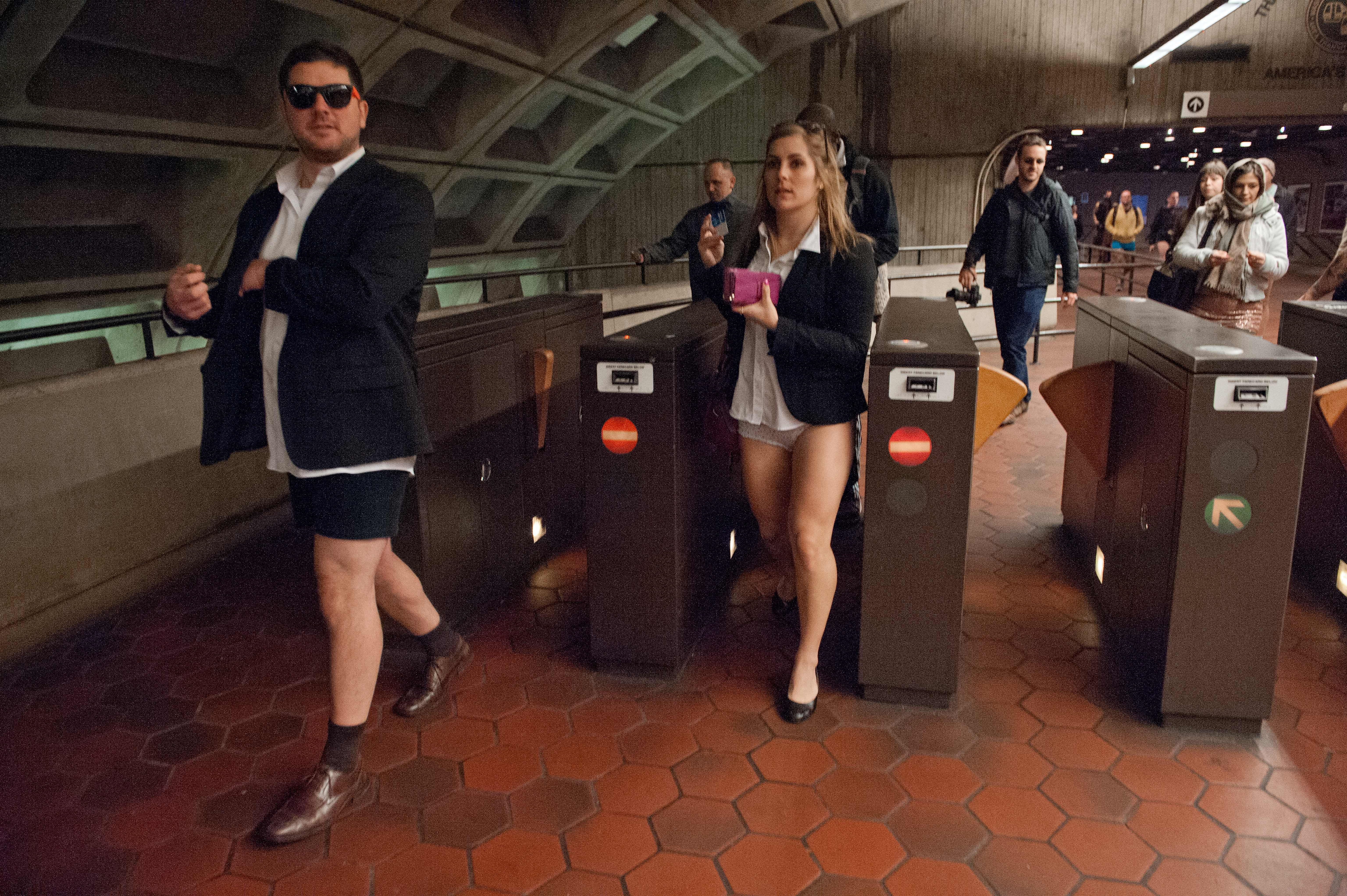 "People taking part in the ""No Pants Subway Ride"" enter a metro station in Washington on January 12, 2014. ""No Pants Subway Ride"" is an annual event in which transit passengers ride trains without wearing pants in January. The event is observed in dozens of cities worldwide. (Photo: NICHOLAS KAMM/AFP/Getty Images)"