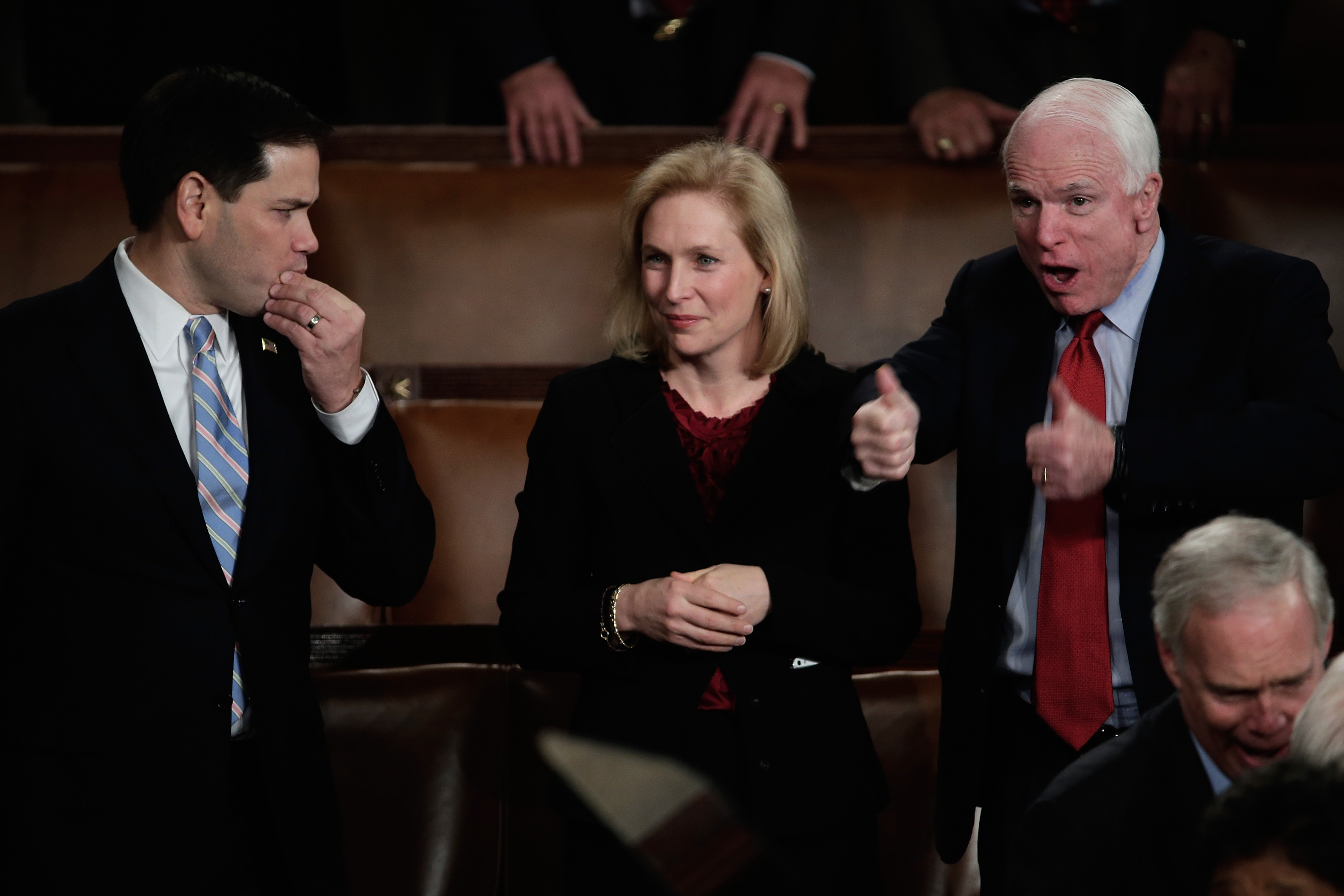 WASHINGTON, DC - JANUARY 28: (L-R) U.S. Sen. Marco Rubio (R-FL), U.S. Sen. Kristen Gillibrand (D-NY) , and U.S. Sen. John McCain (R-AZ) wait for U.S. President Barack Obama to deliver the State of the Union address to a joint session of Congress in the House Chamber at the U.S. Capitol on January 28, 2014 in Washington, DC. In his fifth State of the Union address, Obama is expected to emphasize on healthcare, economic fairness and new initiatives designed to stimulate the U.S. economy with bipartisan cooperation. (Photo by Win McNamee/Getty Images)