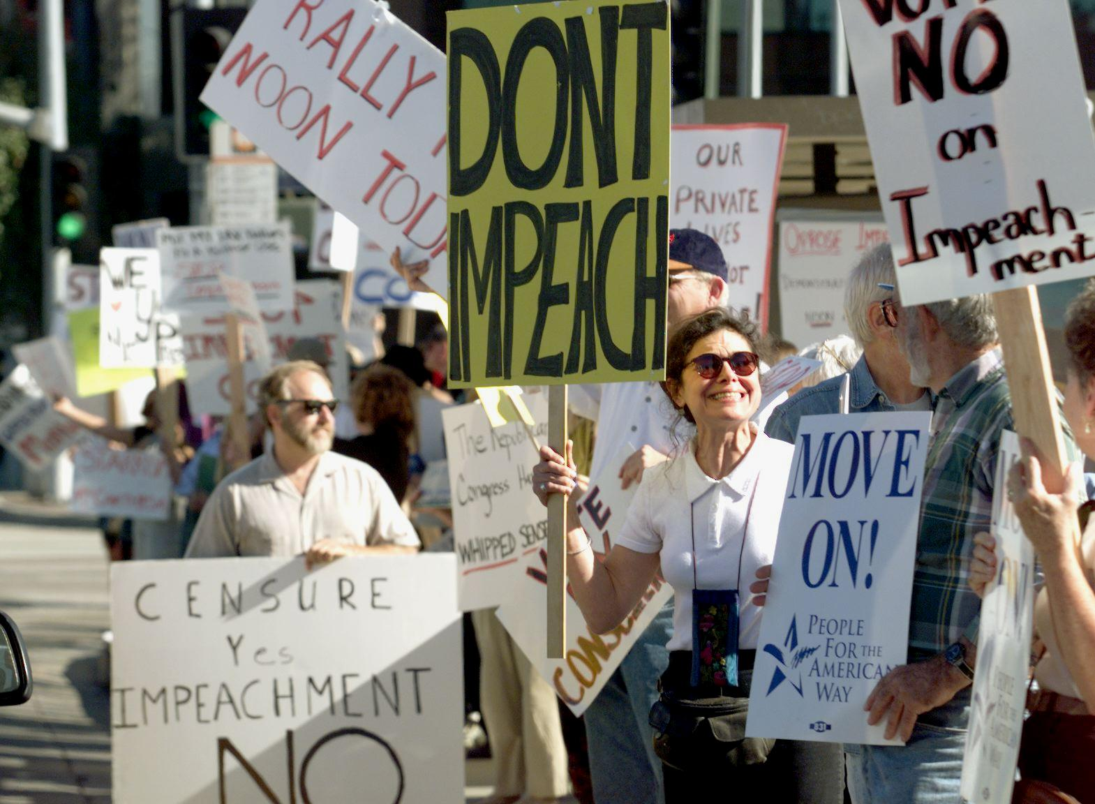 A group of people demonstrate to stop the impeachment process against US President Bill Clinton 16 December in front of the Federal Building in Westwood, outside of Los Angeles, CA. (Photo credit should read HECTOR MATA/AFP/Getty Images)
