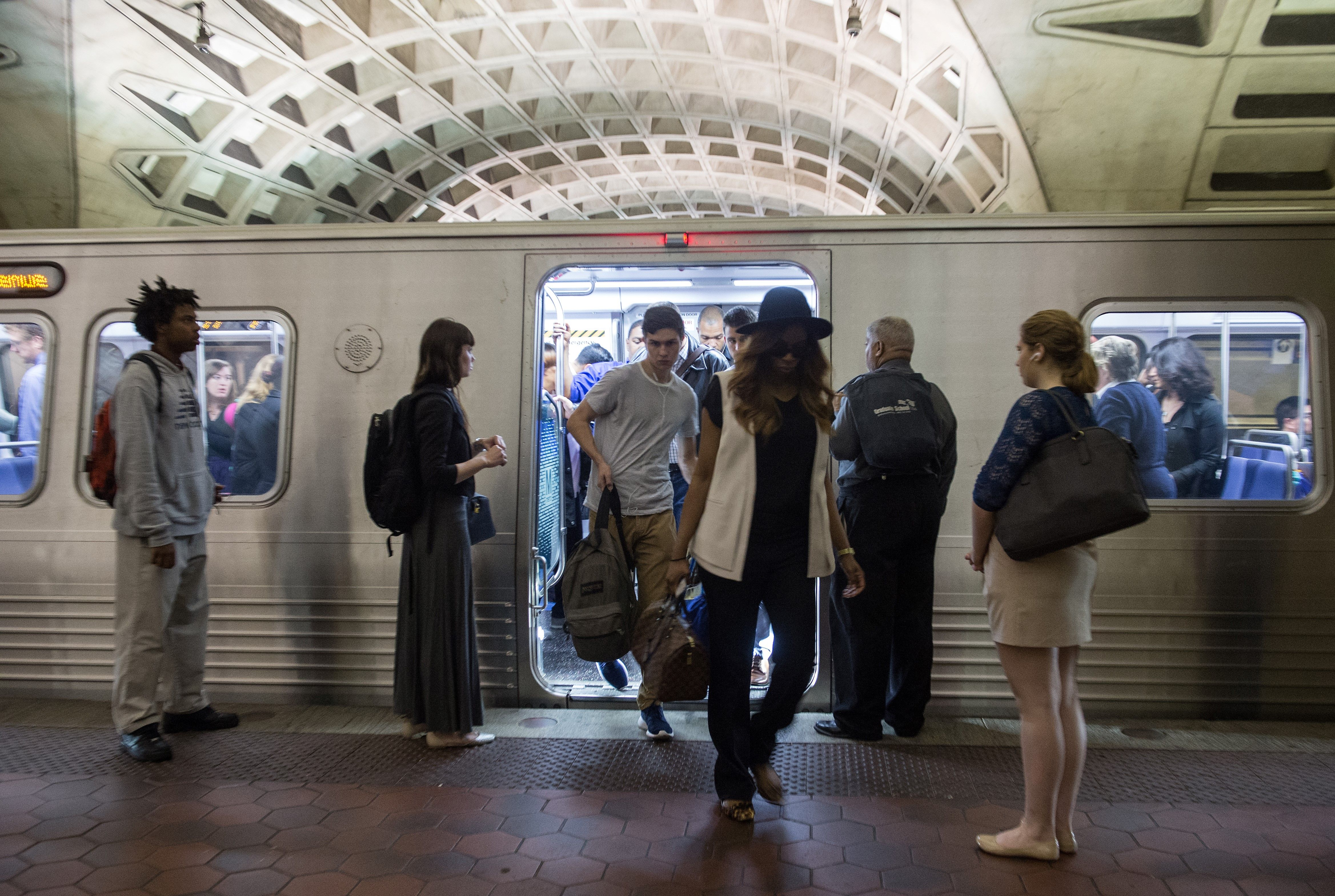 Commuters get off a Metro train as others wait to go aboard at the L'Enfant Plaza station in Washington, DC, on May 24, 2016. (Photo: NICHOLAS KAMM/AFP/Getty Images)