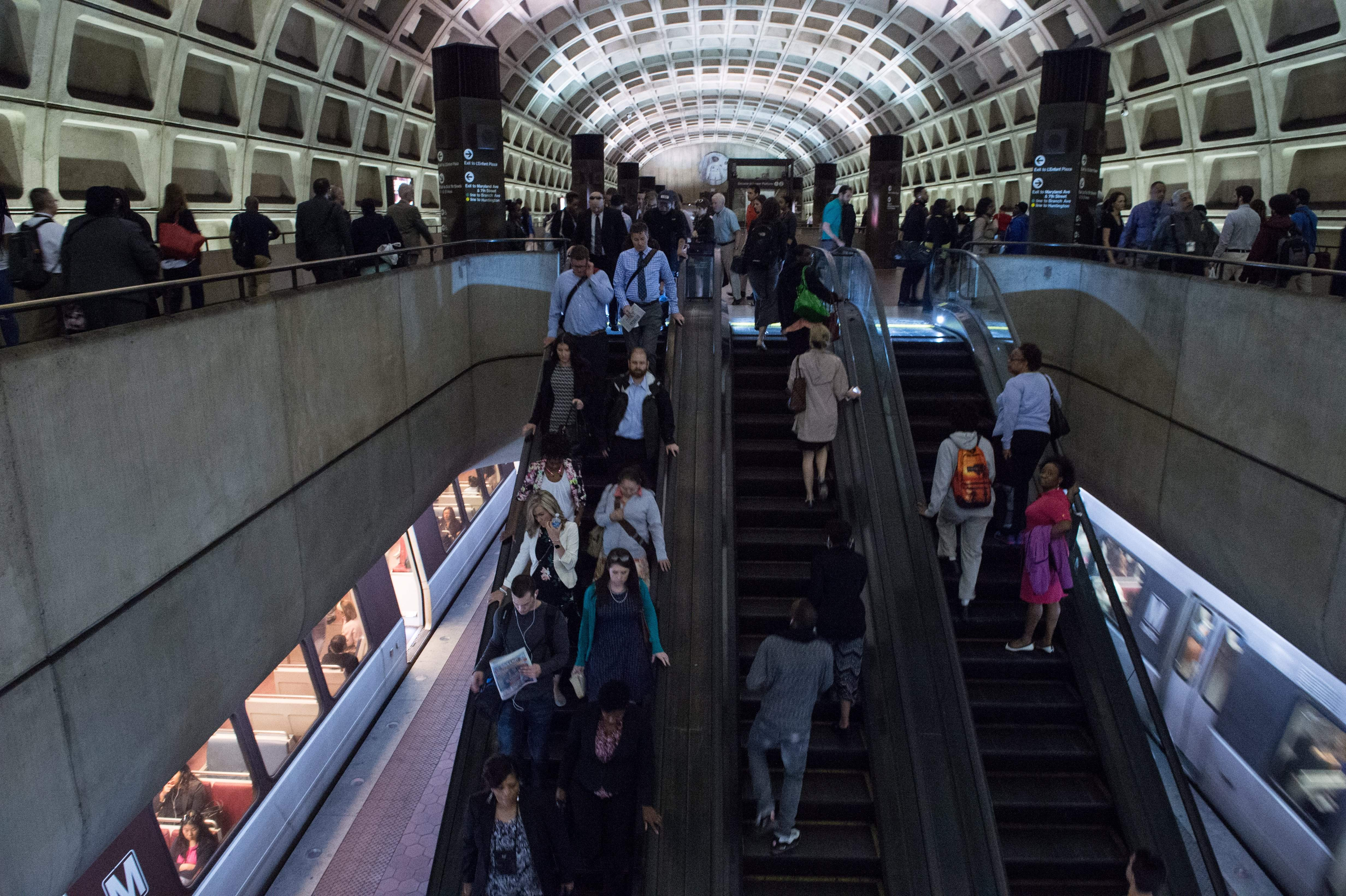 Commuters use the escalators at the L'Enfant Plaza station in Washington, DC, on May 24, 2016. (Photo: NICHOLAS KAMM/AFP/Getty Images)