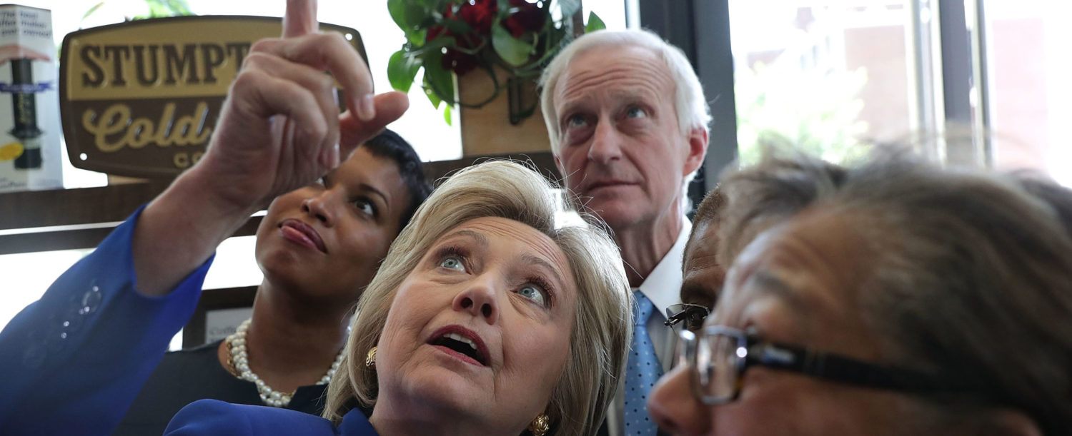 WASHINGTON, DC - JUNE 10: Anticlockwise from center, Democratic presidential candidate Hillary Clinton, DC Councilmember Anita Bonds, DC Councilmember Jack Evans and DC Mayor Muriel Bowser share a moment during a visit to Uprising Muffin Company June 10, 2016 in Washington, DC. (Photo by Alex Wong/Getty Images)