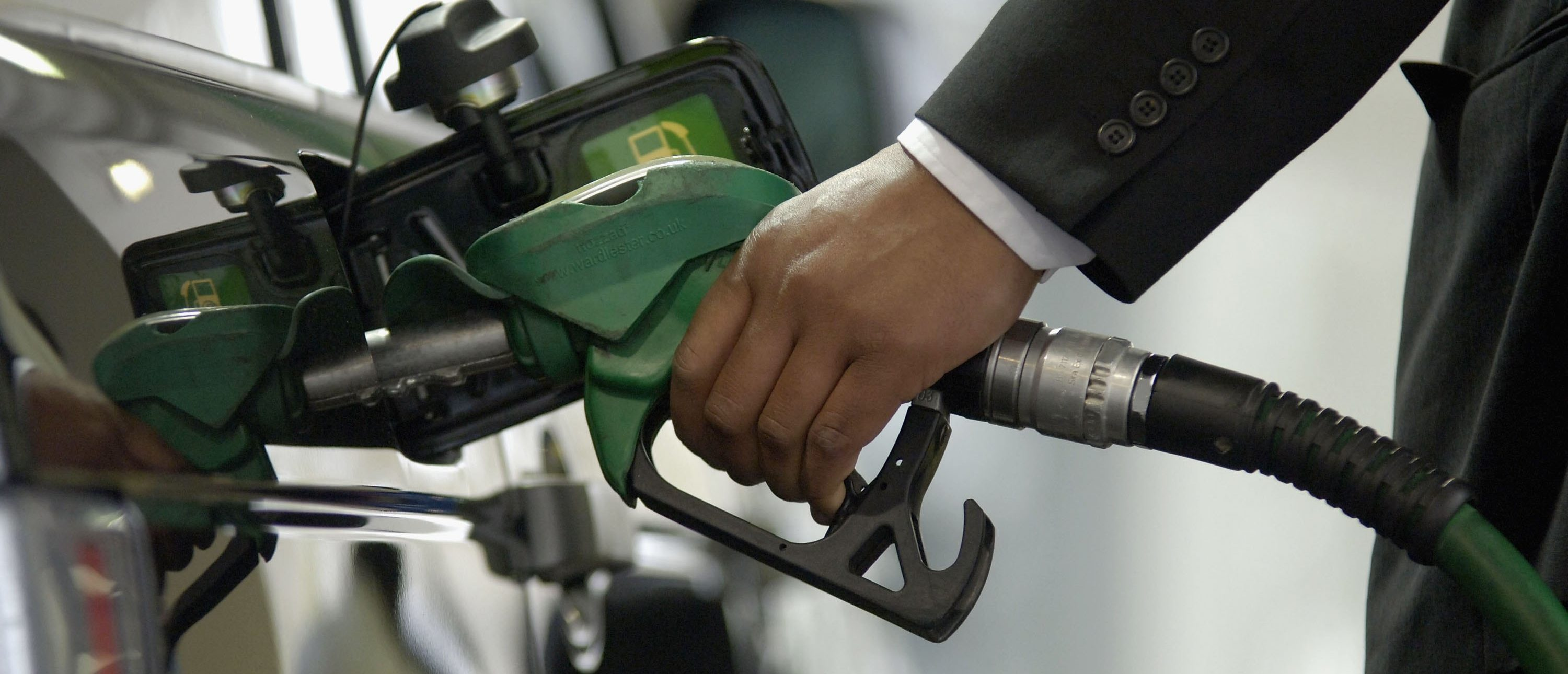 LONDON - APRIL 20: A customer fills his petrol tank at BP petrol station on Park Lane, April 29, 2006 in London, England. Crude oil has hit a record high of $74.22 a barrel on the seventh consecutive day, setting a new price peak. (Photo by Toby Williams/Getty Images)