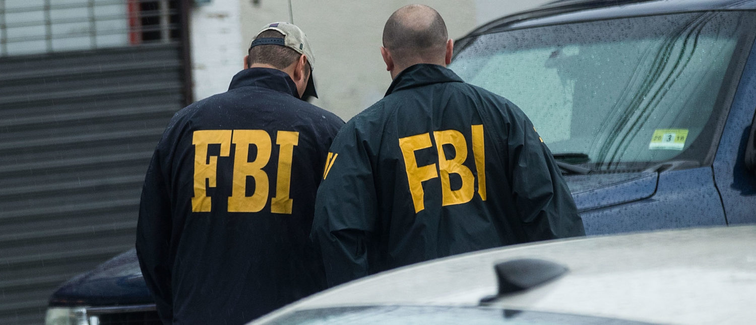 ELIZABETH, NJ - SEPTEMBER 19: Members of the Federal Bureau of Investigation (FBI) investigate a residence in connection to Saturday night's bombing in Manhattan, September 19, 2016 in Elizabeth, New Jersey. On Monday morning, law enforcement released a photograph of 28-year-old Ahmad Khan Rahami, who they are seeking in connection to the attack. First American Fried Chicken, on the ground floor of their home on Elmora Avenue, is owned by Rahami's father Muhammad Raham. (Photo by Drew Angerer/Getty Images)