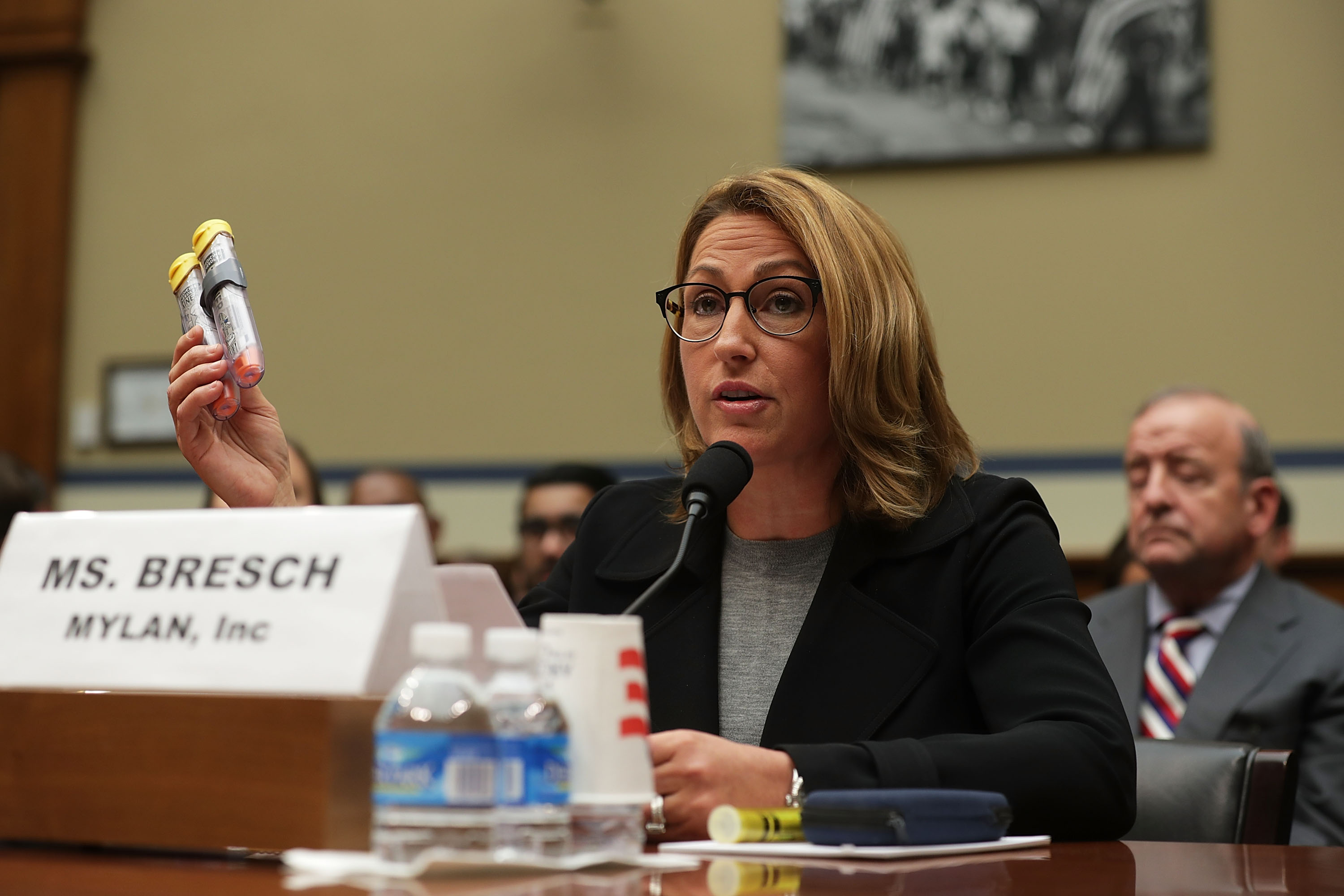 Mylan Inc. CEO Heather Bresch holds up a 2-pack of EpiPen as she testifies during a hearing before the House Oversight and Government Reform Committee September 21, 2016 on Capitol Hill in Washington, DC. (Photo by Alex Wong/Getty Images)