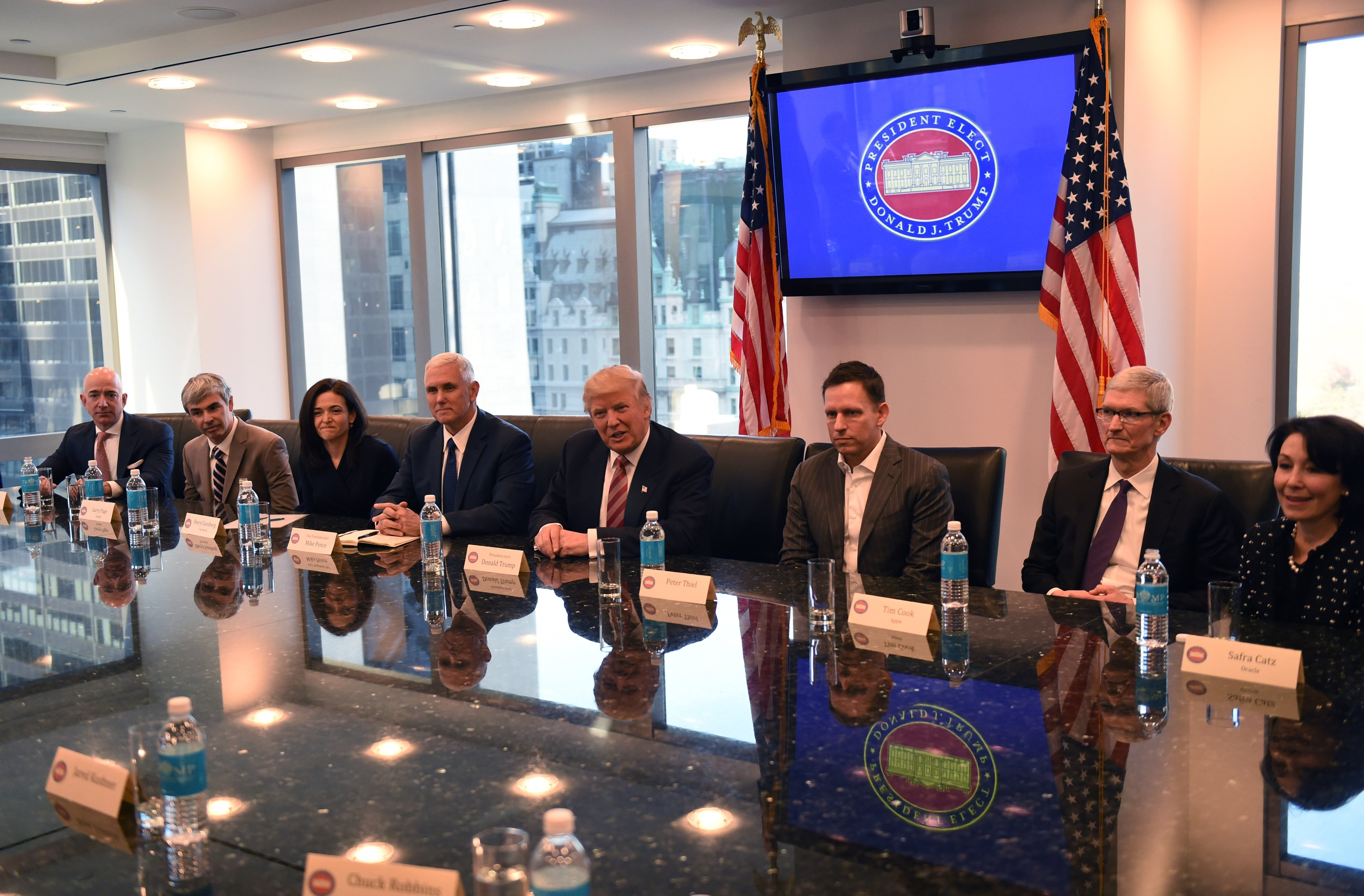 (L-R) Amazon's chief Jeff Bezos, Larry Page of Alphabet, Facebook COO Sheryl Sandberg, Vice President elect Mike Pence, President-elect Donald Trump, Peter Thiel, co-founder and former CEO of PayPal, Tim Cook of Apple and Safra Catz of Oracle attend a meeting at Trump Tower December 14, 2016 in New York. (Photo: TIMOTHY A. CLARY/AFP/Getty Images)