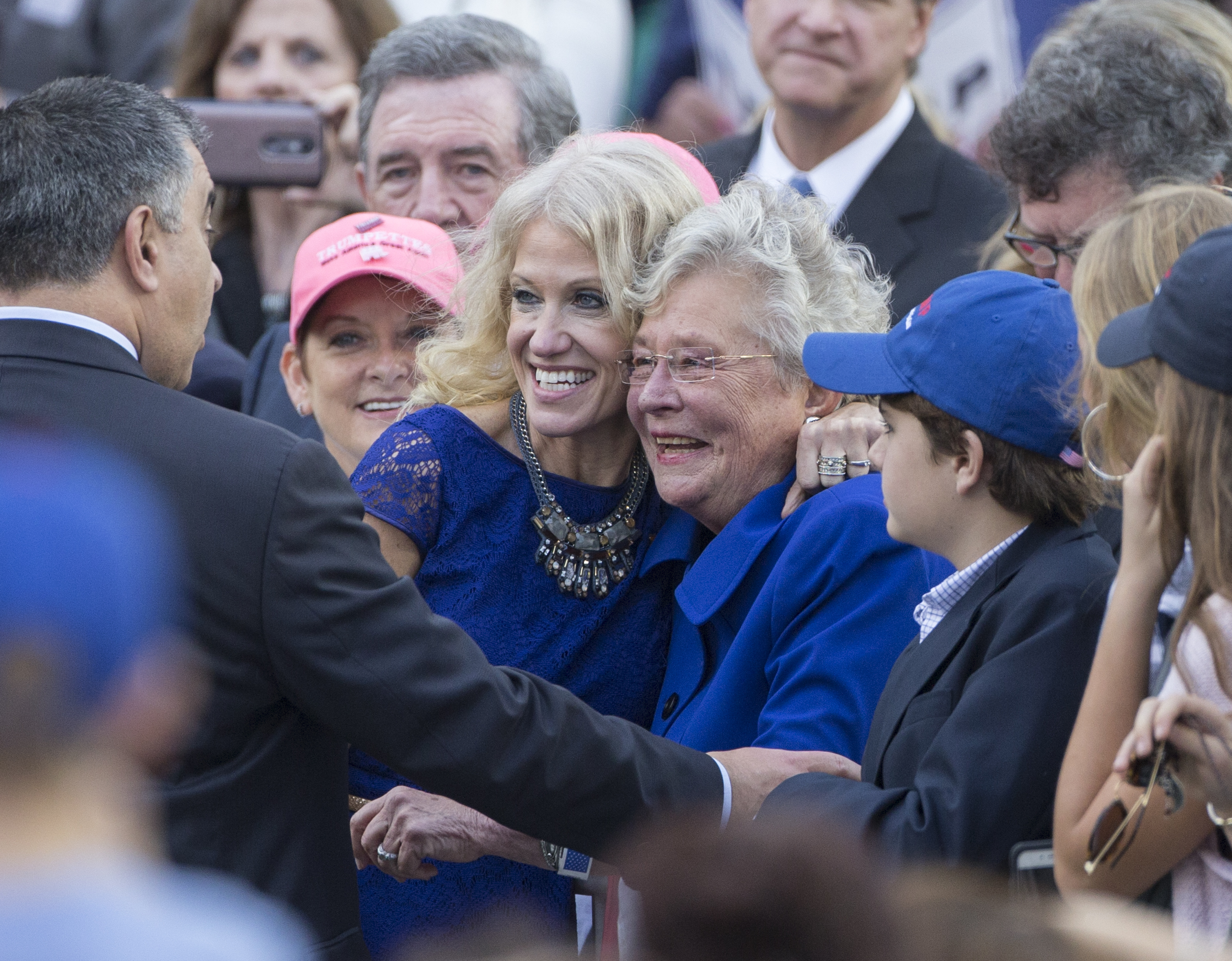 President-elect Donald Trump's campaign manager Kellyanne Conway, left, poses for photos with Alabama Lieutenant Governor Kay Ivey during a thank you rally in Ladd-Peebles Stadium on December 17, 2016 in Mobile, Alabama. (Photo by Mark Wallheiser/Getty Images)