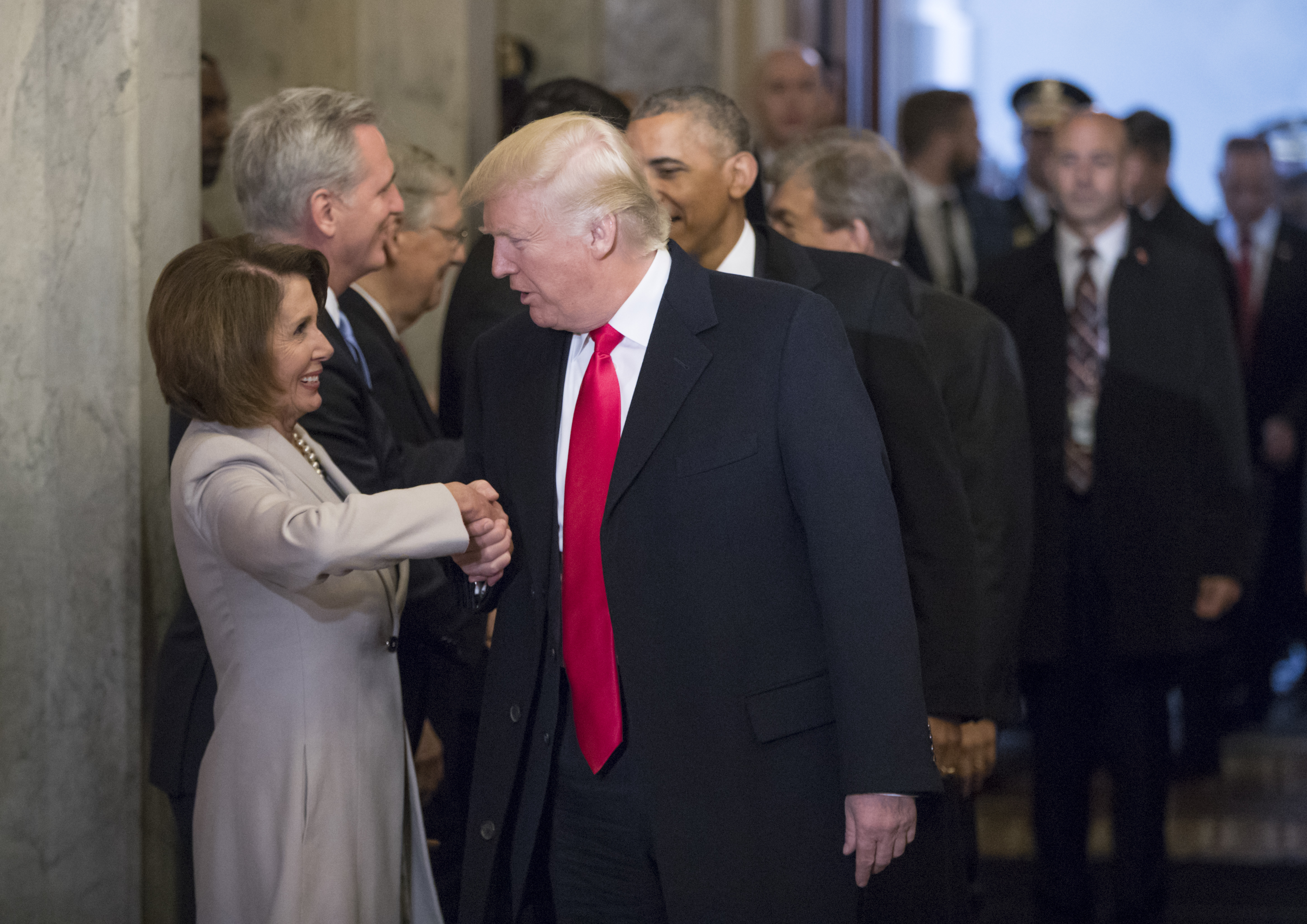 WASHINGTON, DC - JANUARY 20: President-elect Donald Trump (C) and President Barack Obama (R) are greeted by members of the Congressional leadership including House Minority Leader Nancy Pelosi (D-CA) as they arrive for Trump's inauguration ceremony at the Capitol on January 20, 2017 in Washington, DC. Trump became the 45th president of the United States. (Photo by J. Scott Applewhite - Pool/Getty Images)