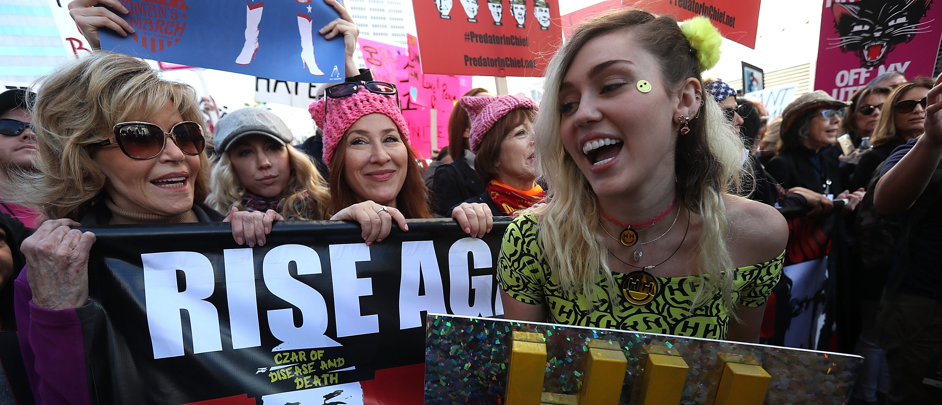LOS ANGELES, CA - JANUARY 21: Actress Jane Fonda (L) and singer Miley Cyrus (R) march during the Women's March on January 21, 2017 in Los Angeles, California. Ten of thousands of people took to the streets of Downtown Los Angeles for the Women's March in protest after the inauguration of President Donald Trump. Women's Marches are being held in cities around the world. (Photo by Justin Sullivan/Getty Images)