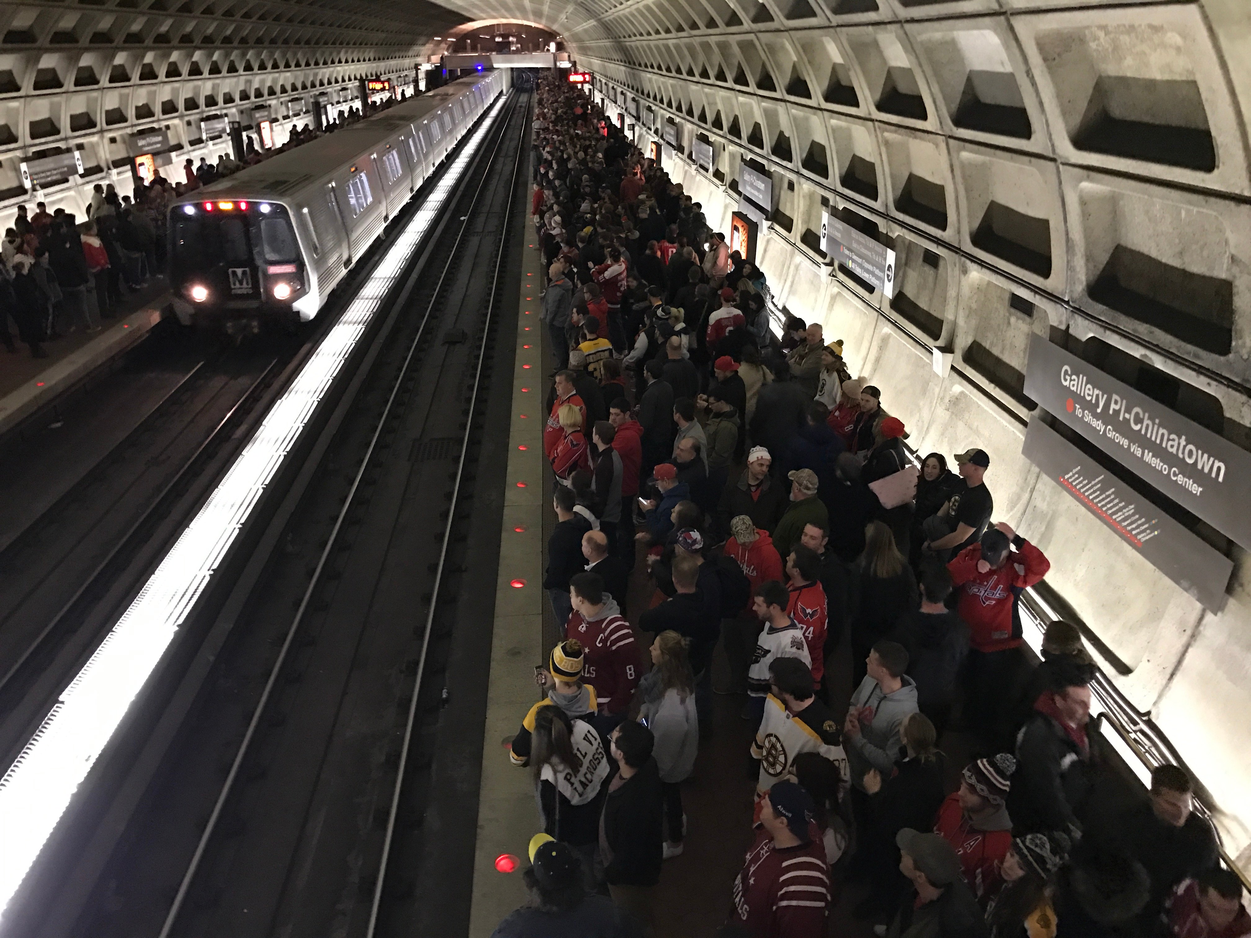 Hockey fans of the Washington Capitals team wait for a metro on February 1st, 2017 after a game at the Verizon center stadium. (Photo: DANIEL SLIM/AFP/Getty Images)