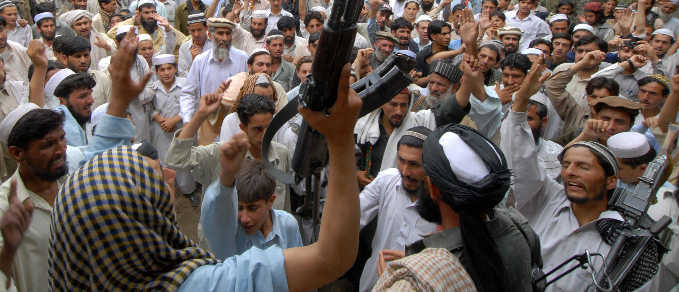 Pakistani alleged Taliban supporters chant anti-US slogans as they gather at the site of a US missile strike in Damadola village in the northwestern Bajaur tribal district which borders Afghanistan's volatile Kunar province, on May 15, 2008. Pakistani militants on May 15 accused the United States of carrying out a missile strike in the country's lawless tribal region and vowed to avenge the attack, which killed at least 12 people. AFP PHOTO/Tariq MAHMOOD (Photo credit should read TARIQ MAHMOOD/AFP/Getty Images)