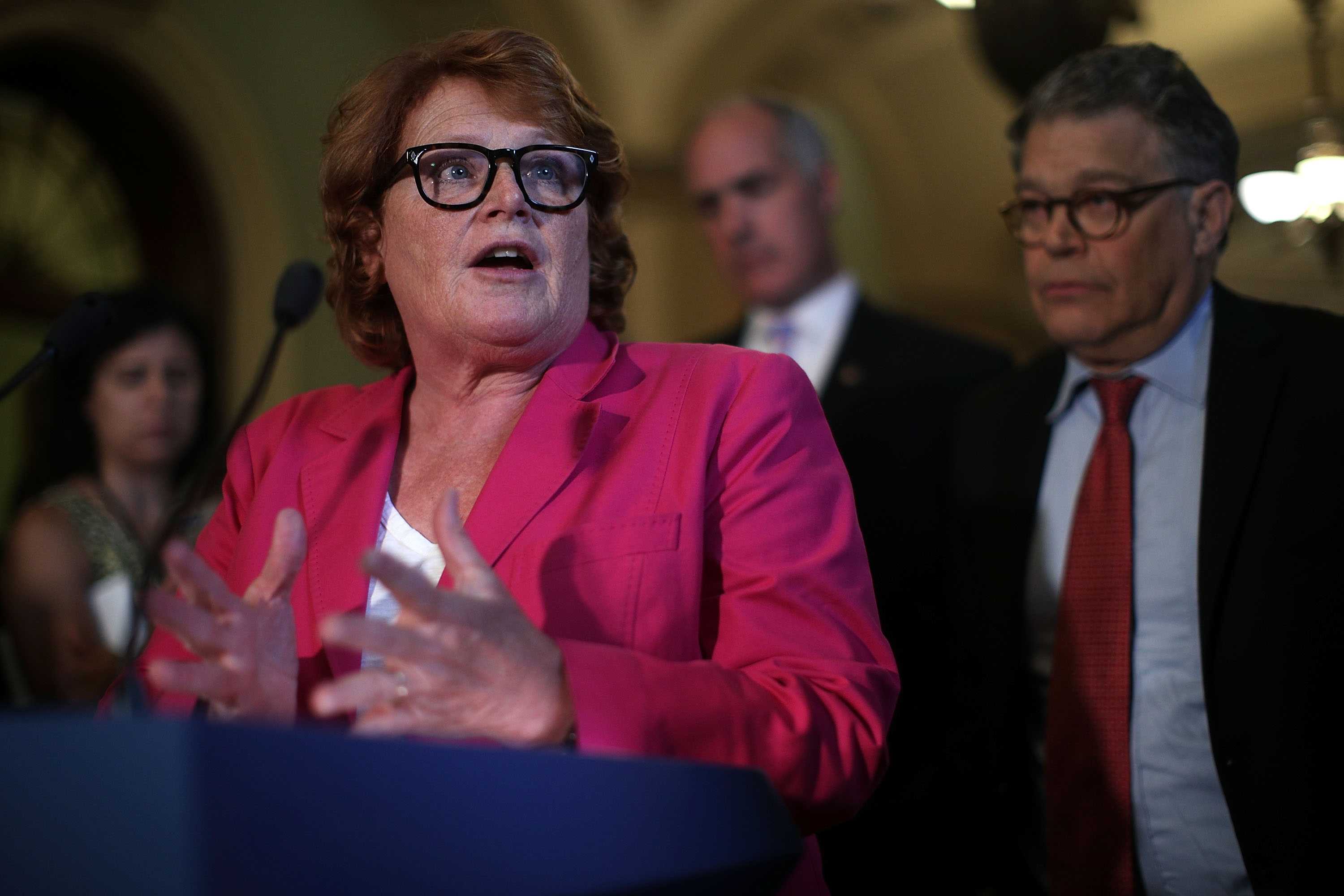 WASHINGTON, DC - JULY 11: U.S. Sen. Heidi Heitkamp (D-ND) (L) speaks as Sen. Al Franken (D-MN) (R) listens during a news briefing after the weekly Senate Democratic Policy Luncheon July 11, 2017 at the Capitol in Washington, DC. Sen. Schumer discussed various topics including Senate's delaying its recess to the third week of August. (Photo by Alex Wong/Getty Images)