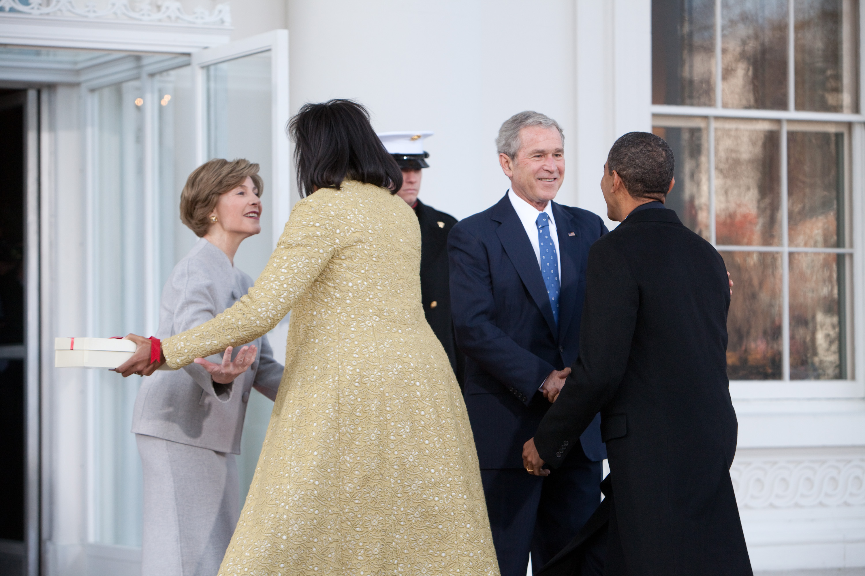 WASHINGTON- JANUARY 20 President George W. Bush and First Lady Laura Bush greet President-elect Barack Obama and Michelle Obama at the North Portico of the White House where the two families will have coffee together before the inaugura