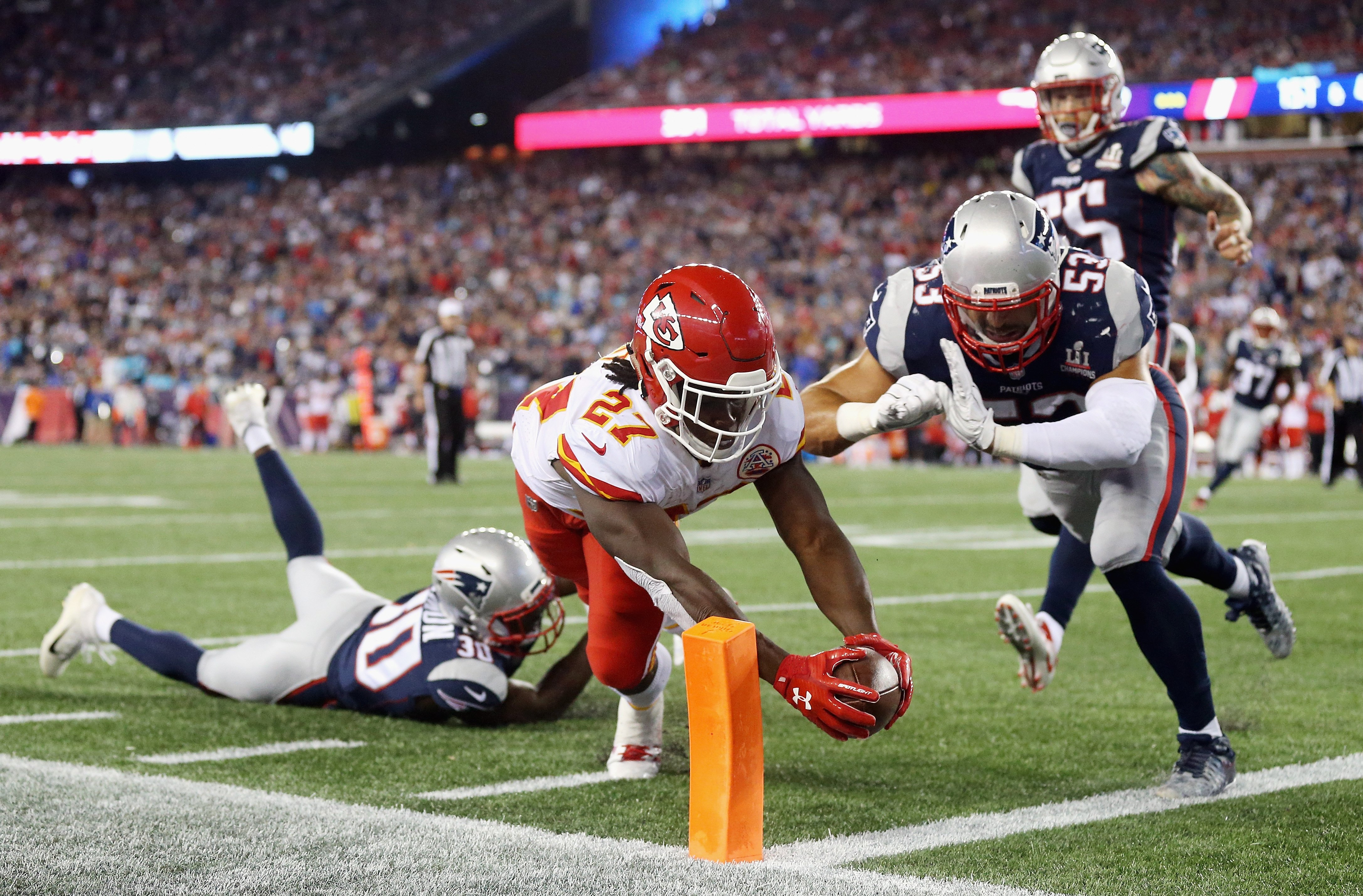 FOXBORO, MA - SEPTEMBER 07: Kareem Hunt #27 of the Kansas City Chiefs dives for the pylon to score a 4-yard rushing touchdown during the fourth quarter against the New England Patriots at Gillette Stadium on September 7, 2017 in Foxboro, Massachusetts. (Photo by Maddie Meyer/Getty Images)