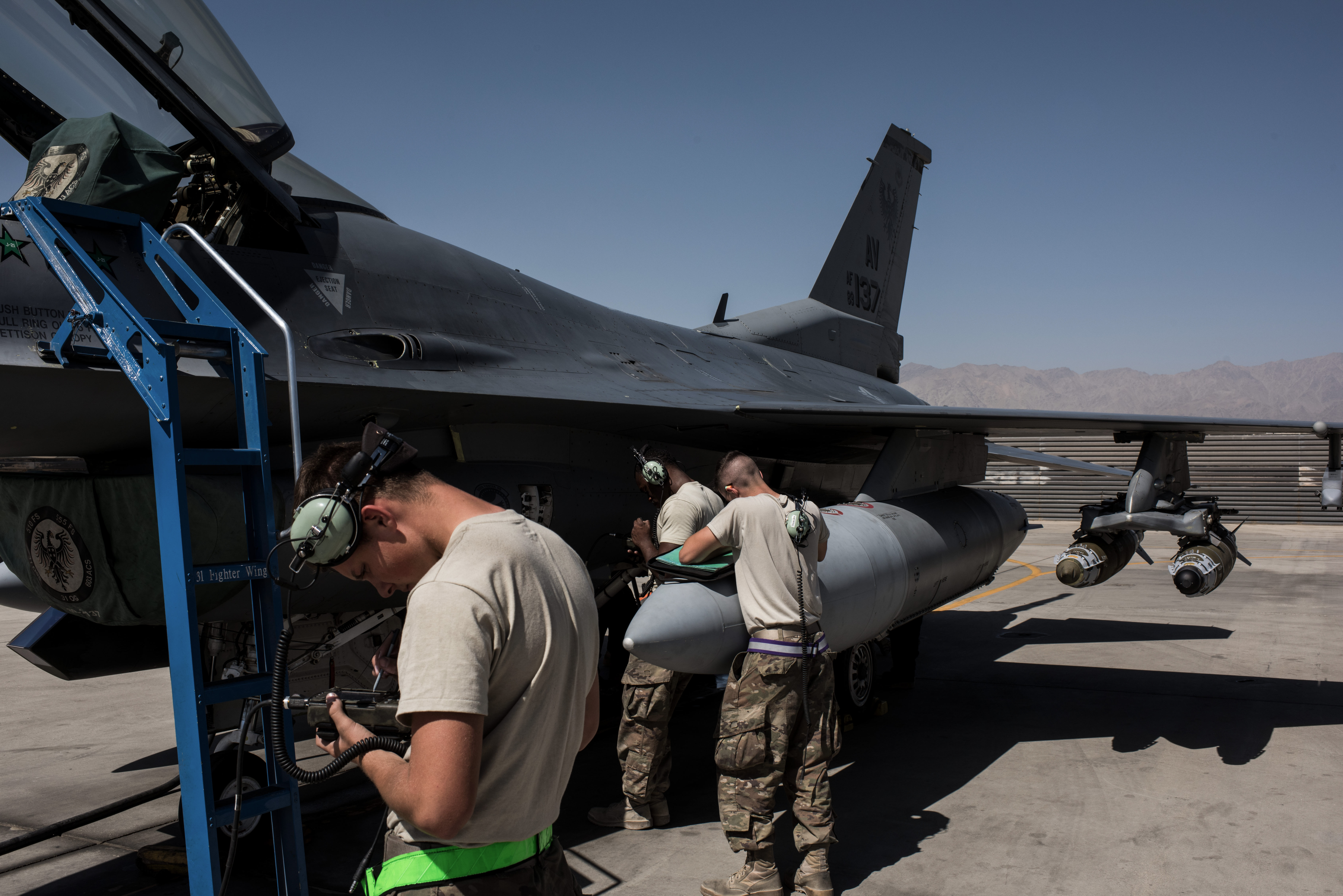 Members of the United States Air Force deployed for Mission Resolute Support prepare an F-16 Jet for a flight at Bagram Air Field on September 5, 2017 in Bagram, Afghanistan. (Photo by Andrew Renneisen/Getty Images)