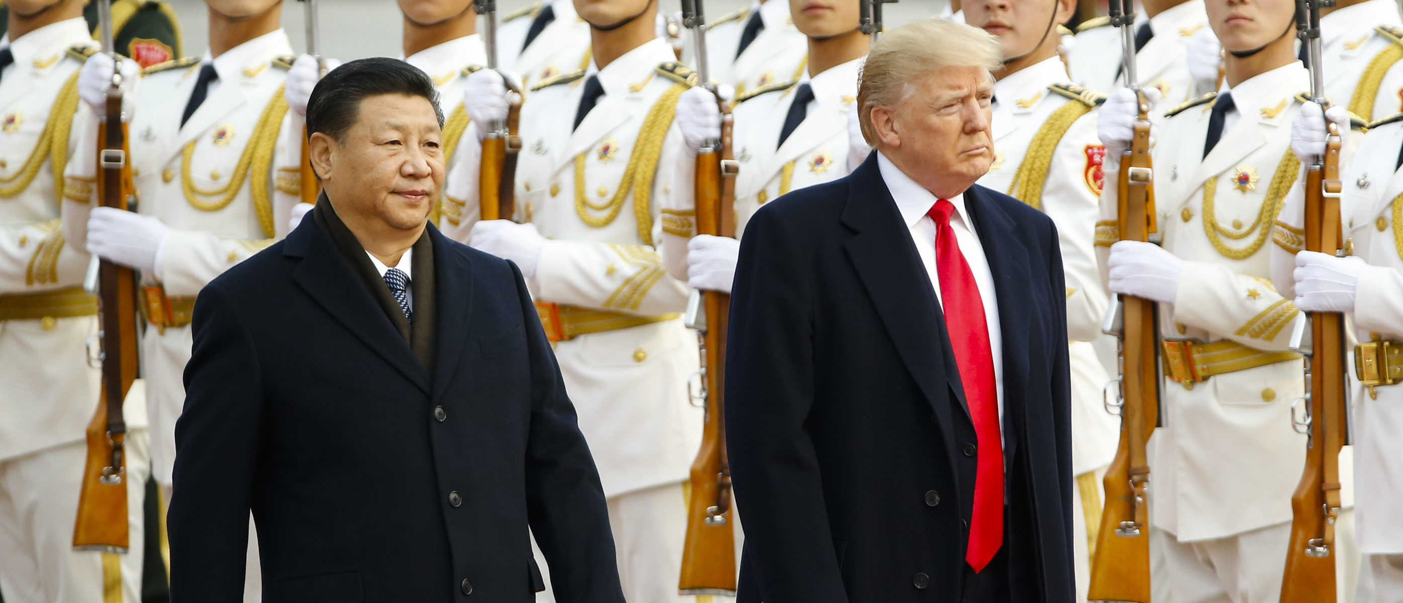 BEIJING, CHINA - NOVEMBER 9: U.S. President Donald Trump takes part in a welcoming ceremony with China's President Xi Jinping on November 9, 2017 in Beijing, China. Trump is on a 10-day trip to Asia. (Photo by Thomas Peter-Pool/Getty Images)