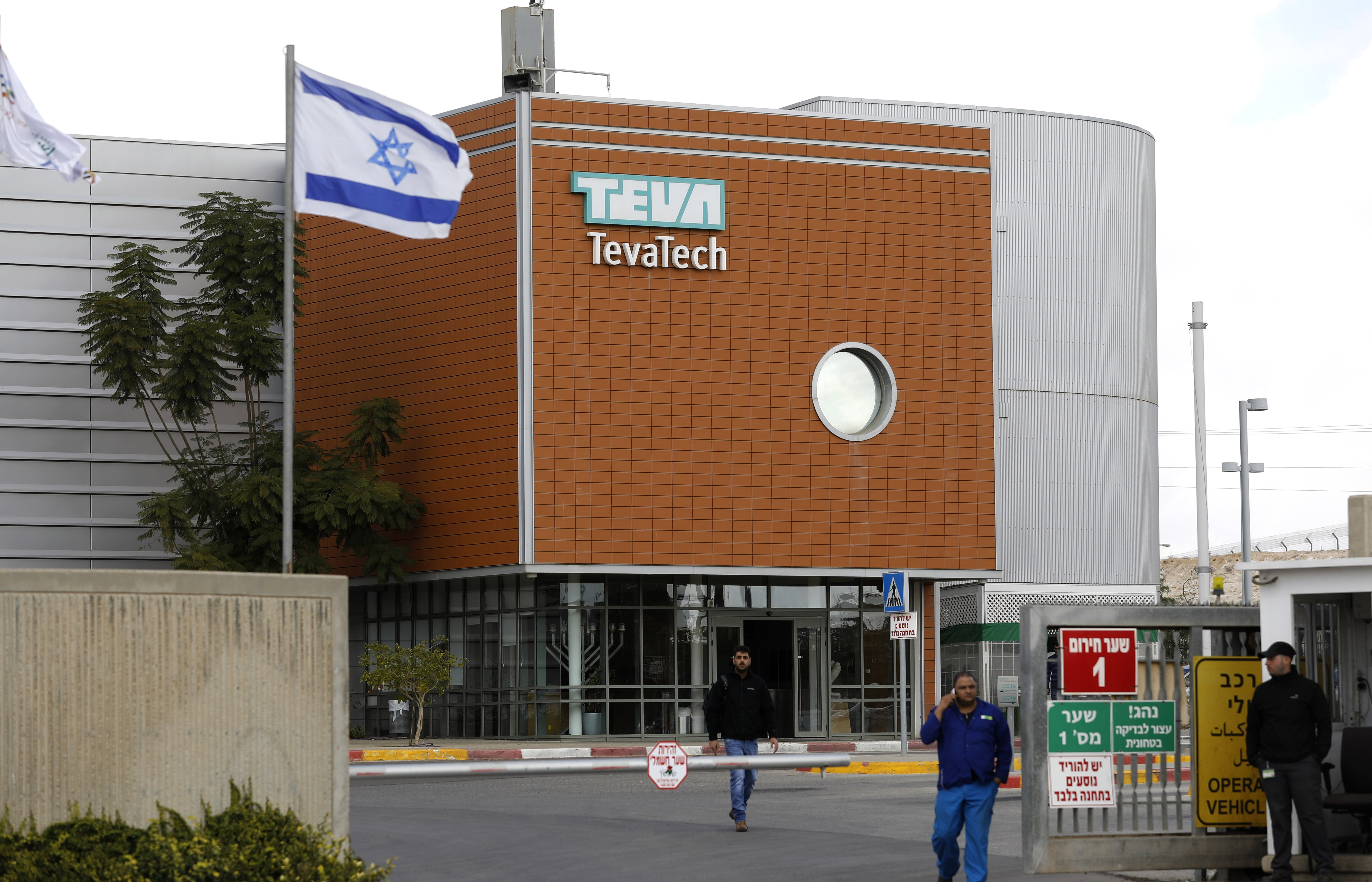 Israeli employees of Teva, the world's biggest manufacturer of generic drugs, gather outside the pharmaceutical company's plant in Ne'ot Hovav, an industrial south of Beersheva, on December 14, 2017. (MENAHEM KAHANA/AFP/Getty Images)