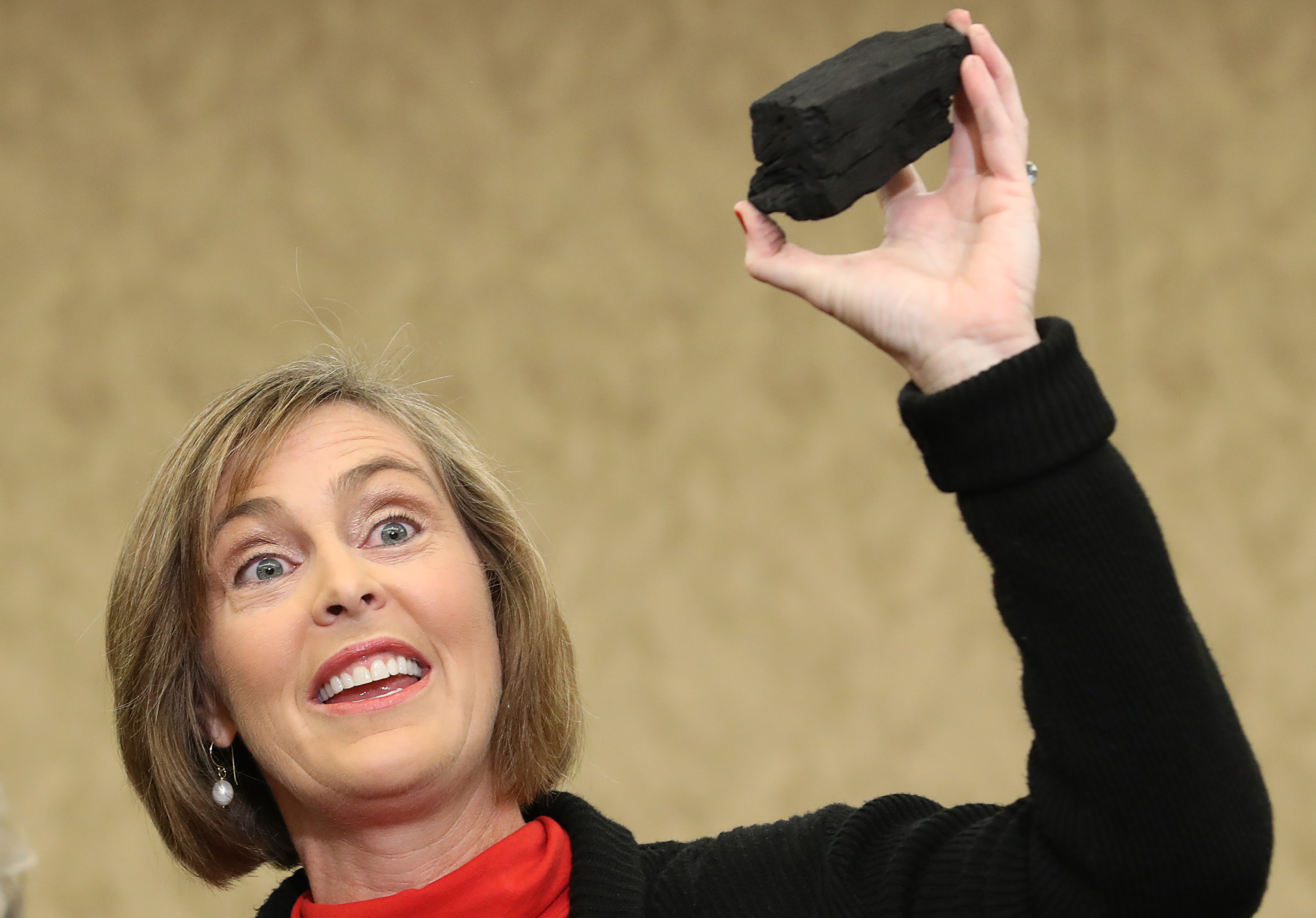 "WASHINGTON, DC - DECEMBER 20: Rep. Kathy Castor (D-FL) holds up a symbolic piece of coal for the holiday season during a press conference with the Democratic Women's Working Group on the Children's Health Insurance Program at the U.S. Capitol December 20, 2017 in Washington, DC. The coal was used to symbolize the Democratic contention that Republican members of Congress need to ""drop their partisan CHIP reauthorization and adopt reasonable offsets to ensure nine million children keep their health care."" (Photo by Win McNamee/Getty Images)"