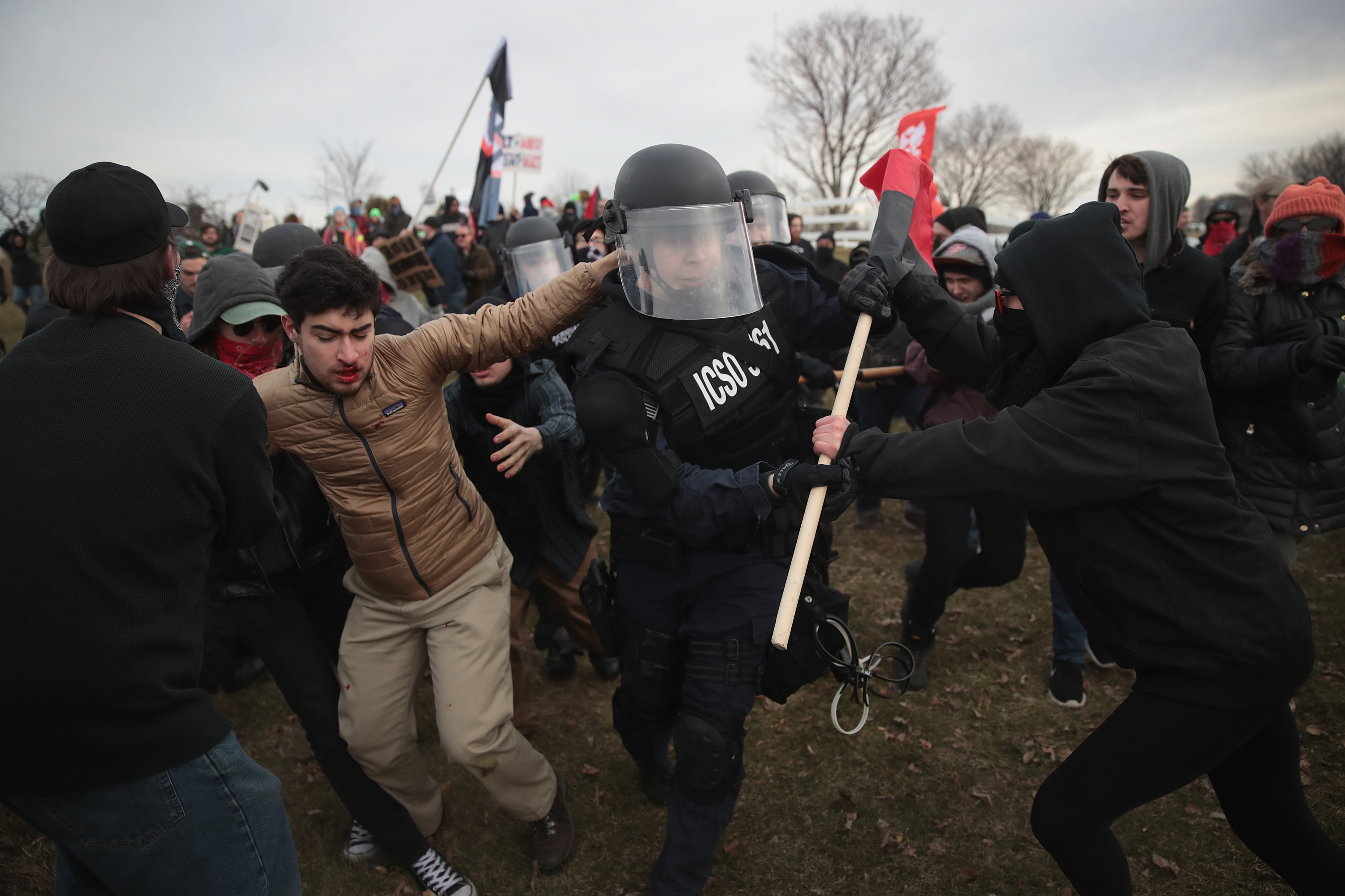 EAST LANSING, MI - MARCH 05: Police clash with demonstrators as they escort people into a speech by white nationalist Richard Spencer, who popularized the term 'alt-right', at Michigan State University on March 5, 2018 in East Lansing, Michigan. Spencer was granted permission to speak after suing the university which is currently on Spring break. (Photo by Scott Olson/Getty Images)