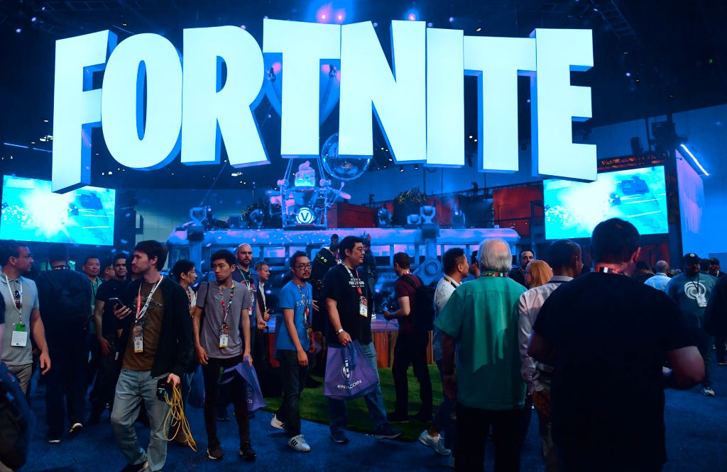 People crowd the display area for the survival game Fortnite at the 24th Electronic Expo, or E3 2018, in Los Angeles, California on on June 12, 2018, where hardware manufacturers, software developers and the video game industry present their new games. (Photo by Frederic J. BROWN / AFP) (Photo credit should read FREDERIC J. BROWN/AFP/Getty Images)
