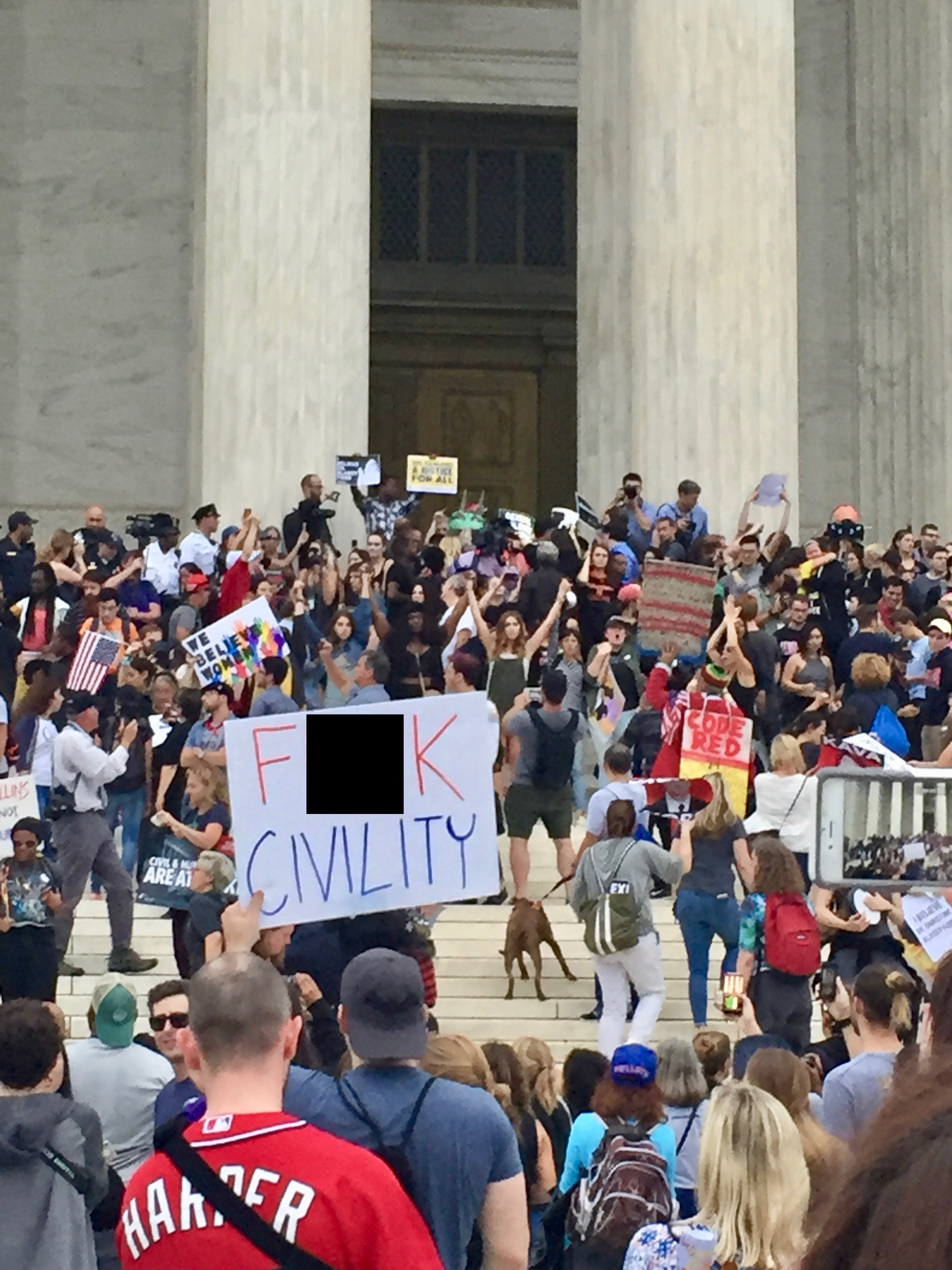 Protesters gather on the steps of the Supreme Court following the Senate confirmation of Brett Kavanaugh on Oct. 6, 2018. (Photo by TheDC/Jon Brown)