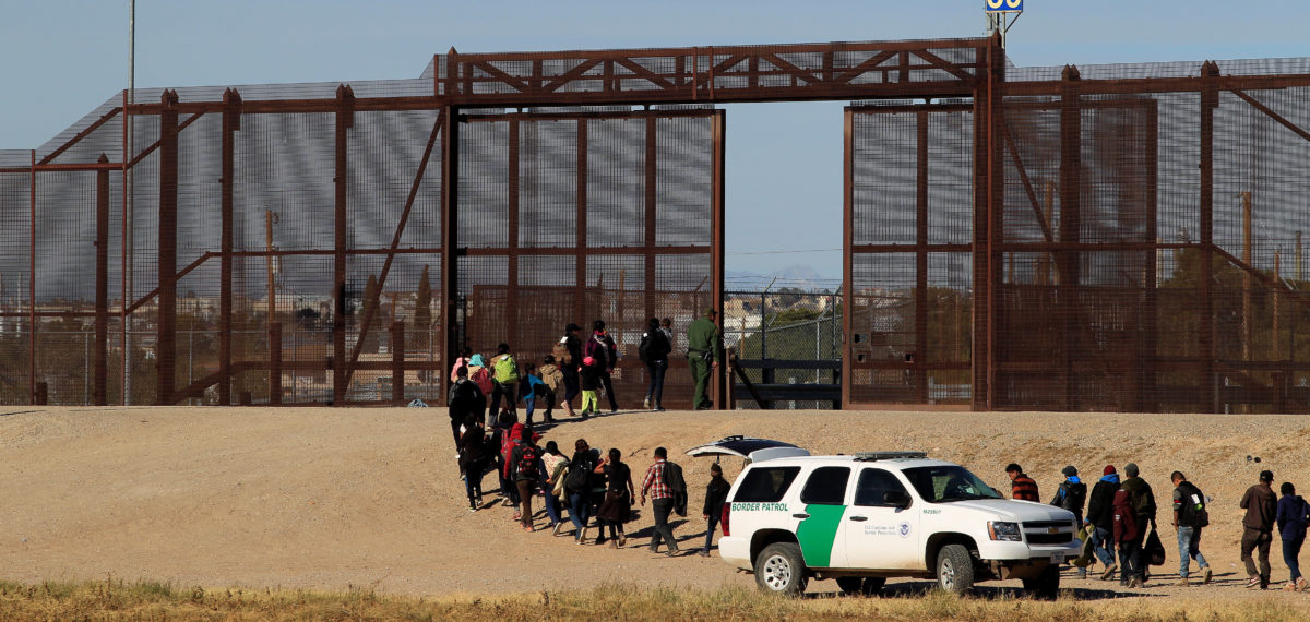 Migrants from Central America are seen escorted by U.S. Customs and Border Protection (CBP) officials after crossing the border from Mexico to surrender to the officials in El Paso, Texas, U.S., in this picture taken from Ciudad Juarez, Mexico December 3, 2018. REUTERS/Jose Luis Gonzalez
