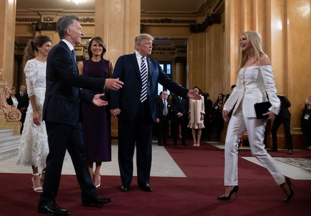 US President Donald Trump (C) calls her daughter White House adviser Ivanka Trump to join her wife US First Lady Melania Trump (3-L), Argentina's President Mauricio Macri (2-L) and his wife Argentina's First Lady Juliana Awada (L), prior to a gala at the Colon Theater in Buenos Aires, on November 30, 2018 in the sidelines of the G20 Leader's Summit. (Photo credit: SAUL LOEB/AFP/Getty Images)