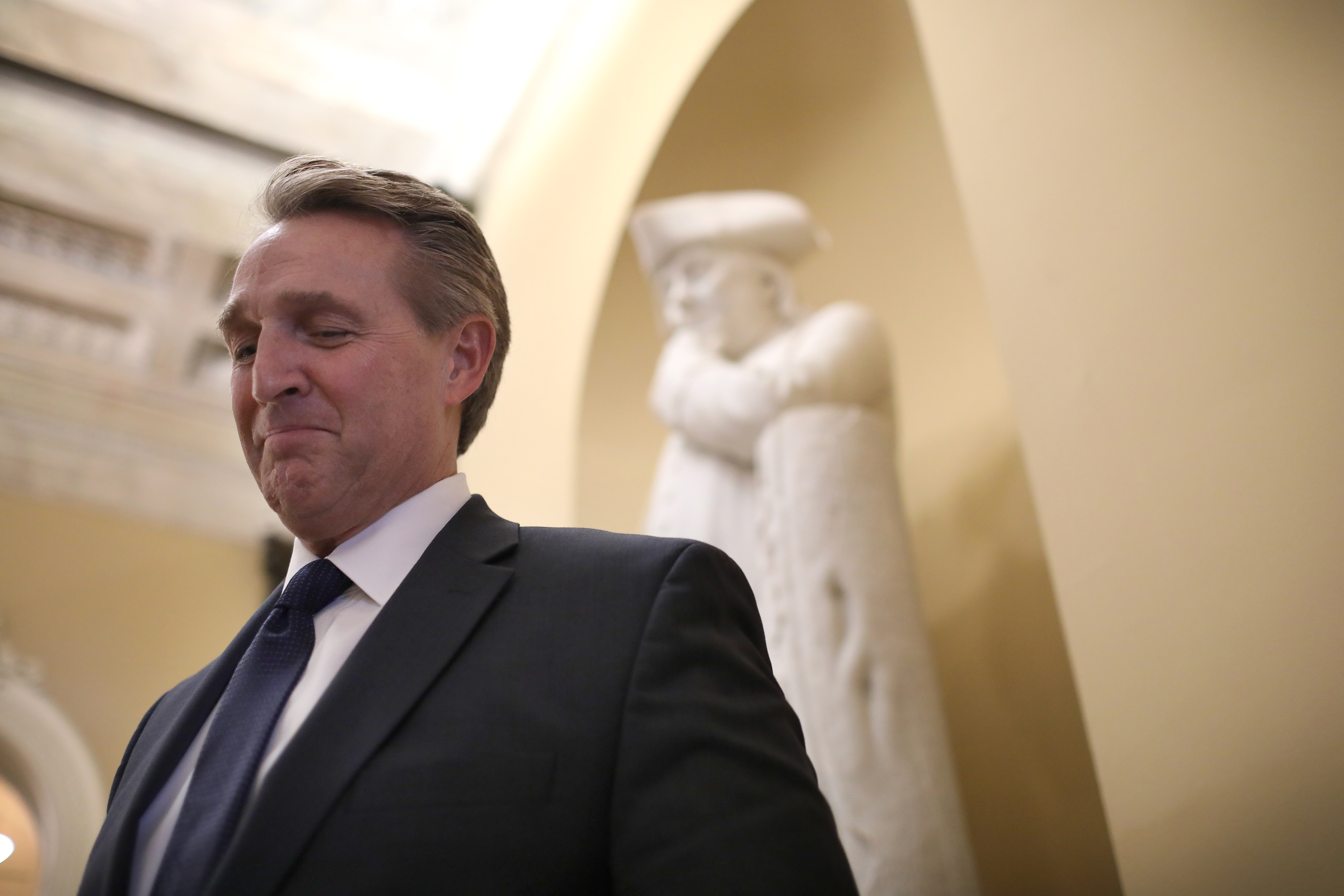 Sen. Jeff Flake answers questions from a reporter after delivering his farewell speech on the floor of the U.S. Senate December 13, 2018 in Washington, DC. (Win McNamee/Getty Images)