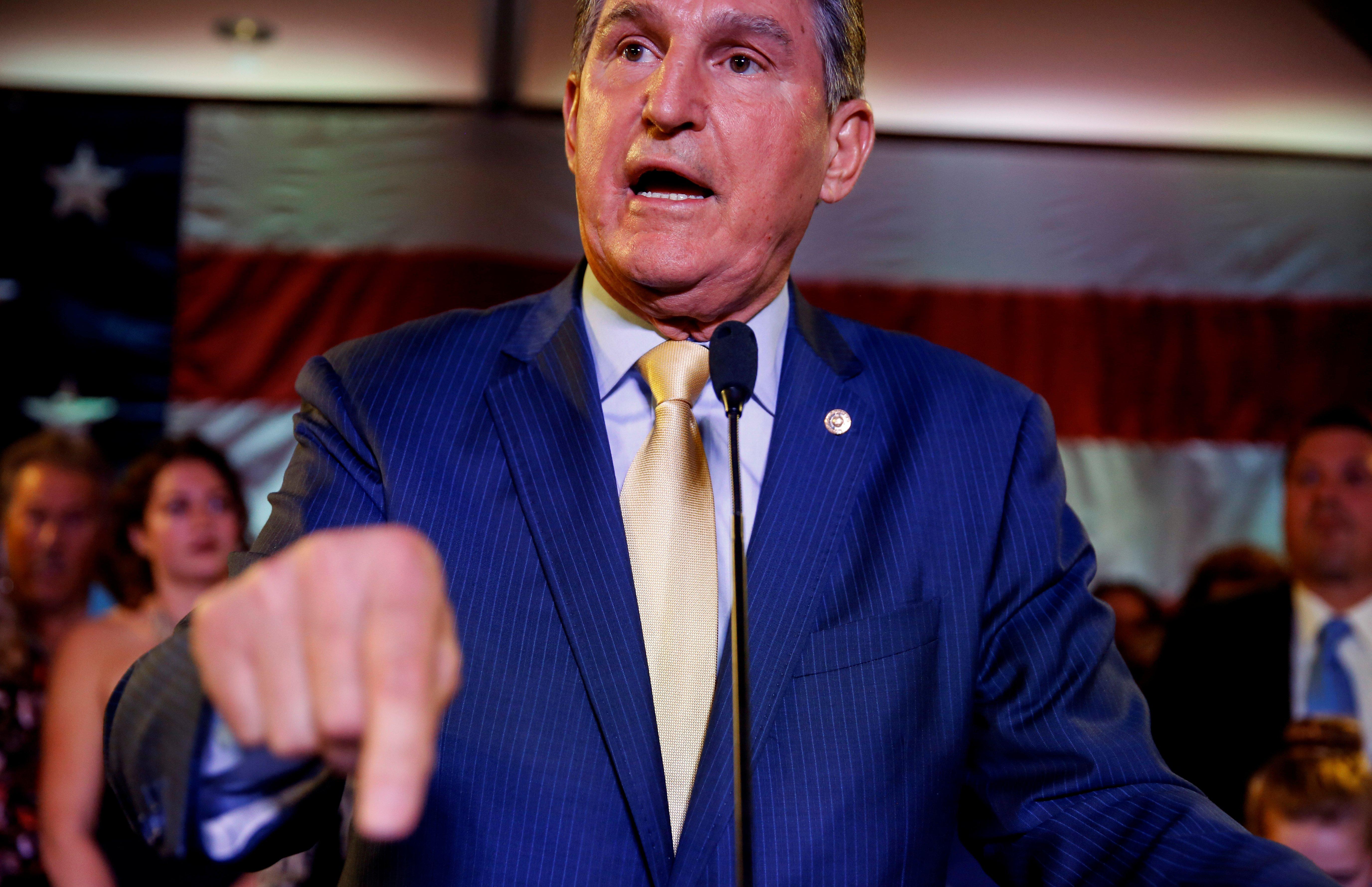 Democratic Senator Joe Manchin speaks after winning his 2018 midterm election in Charlestown, West Virginia, U.S., November 6, 2018. REUTERS/Joshua Roberts